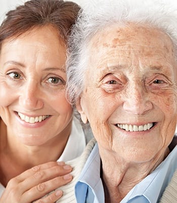 Mother and daughter smiling for the camera here at our beautiful senior living community here at Amber Grove Place in Chico, CA