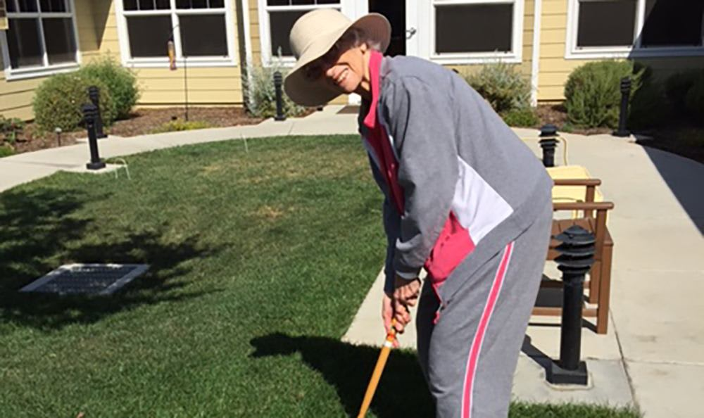 One of our residents here at Amber Grove Place playing a rousing game of croquet!