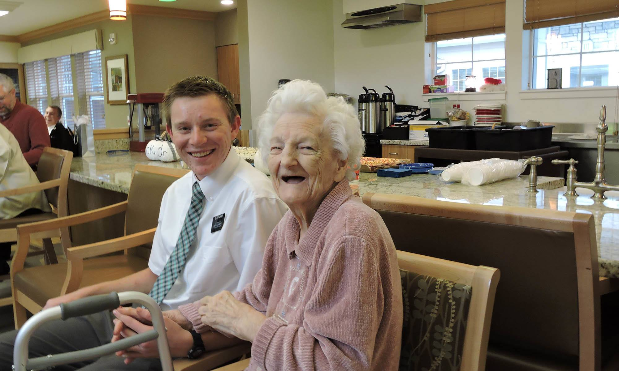 Resident with young man at senior living in Westminster