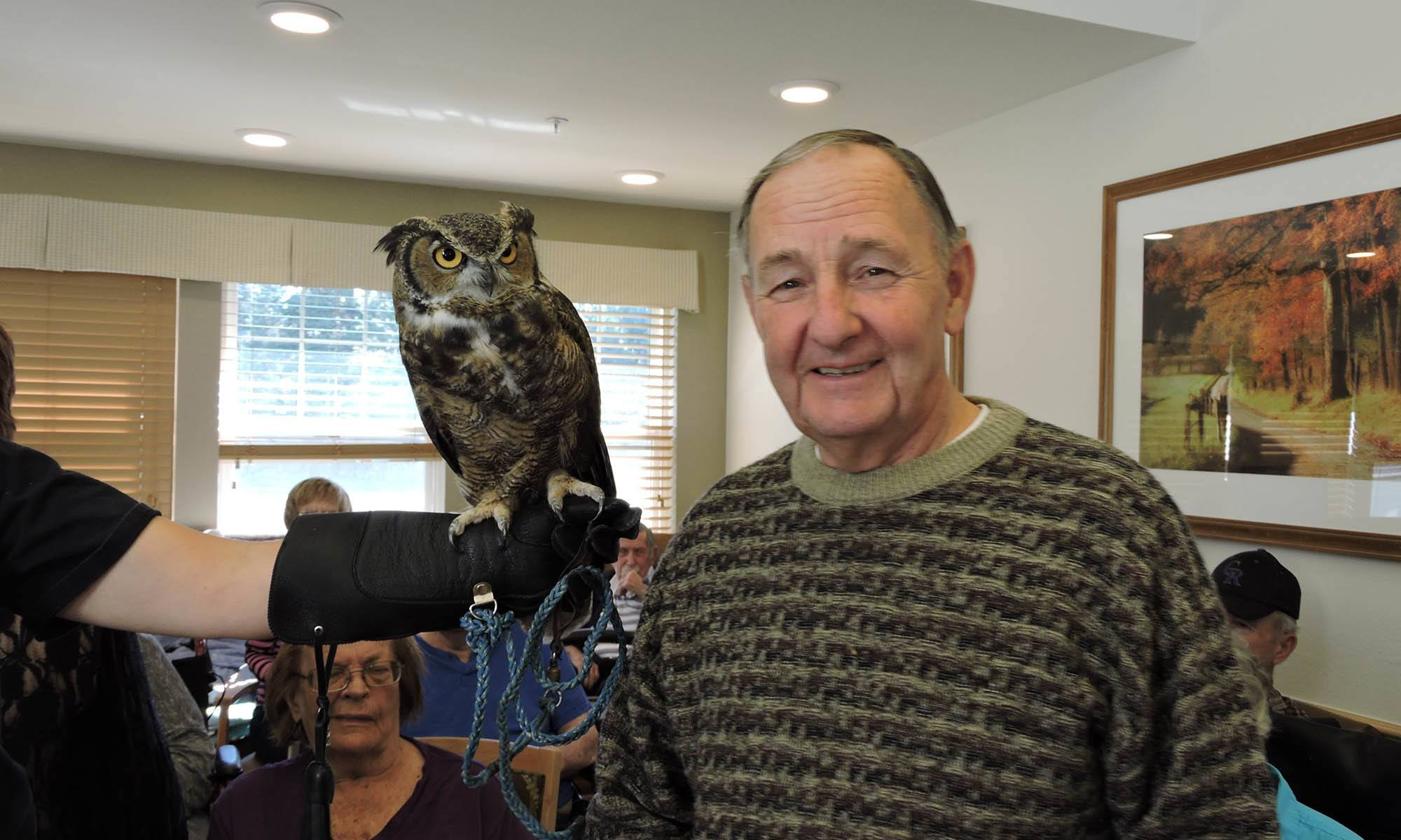 Man with an owl at senior living in IL