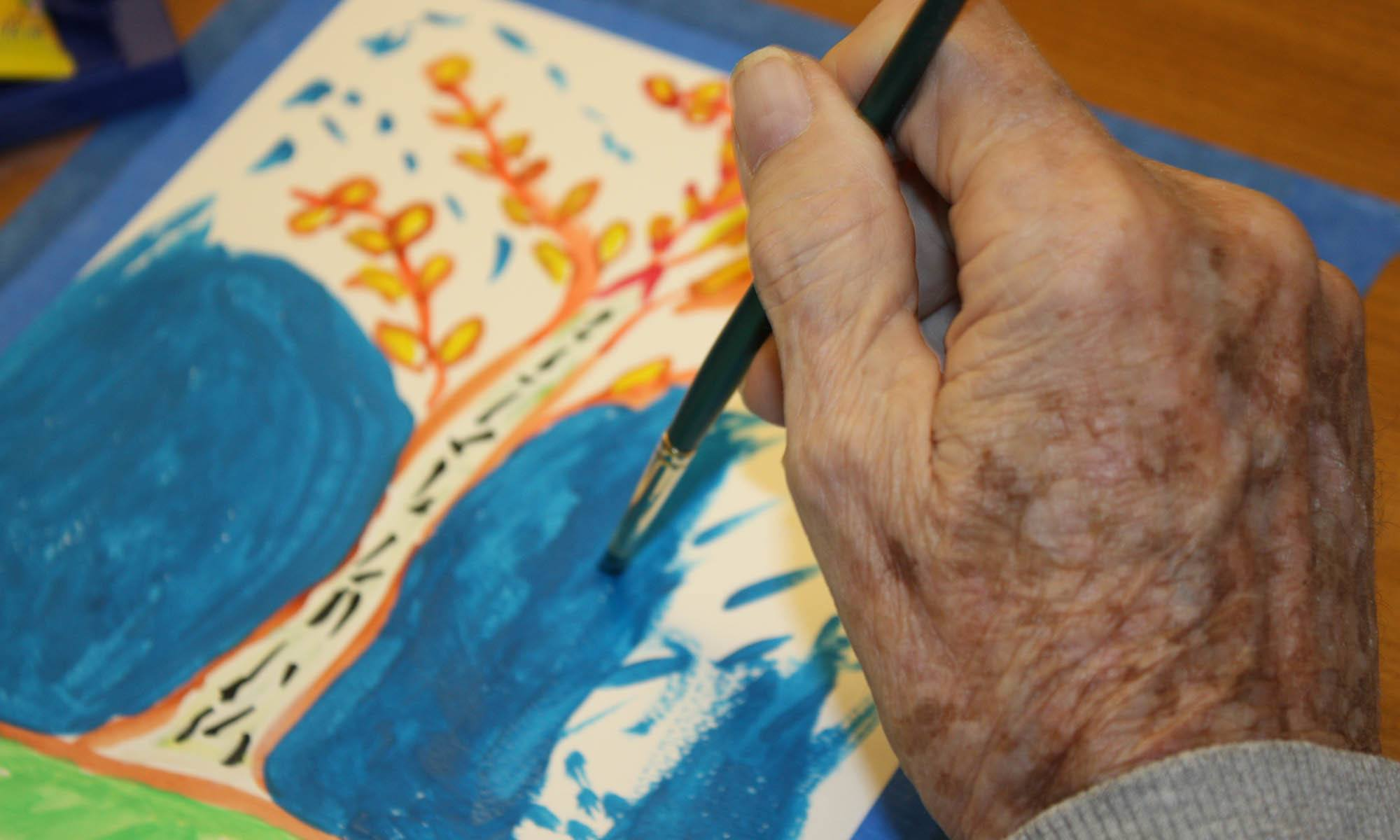 Resident painting at senior living in CO