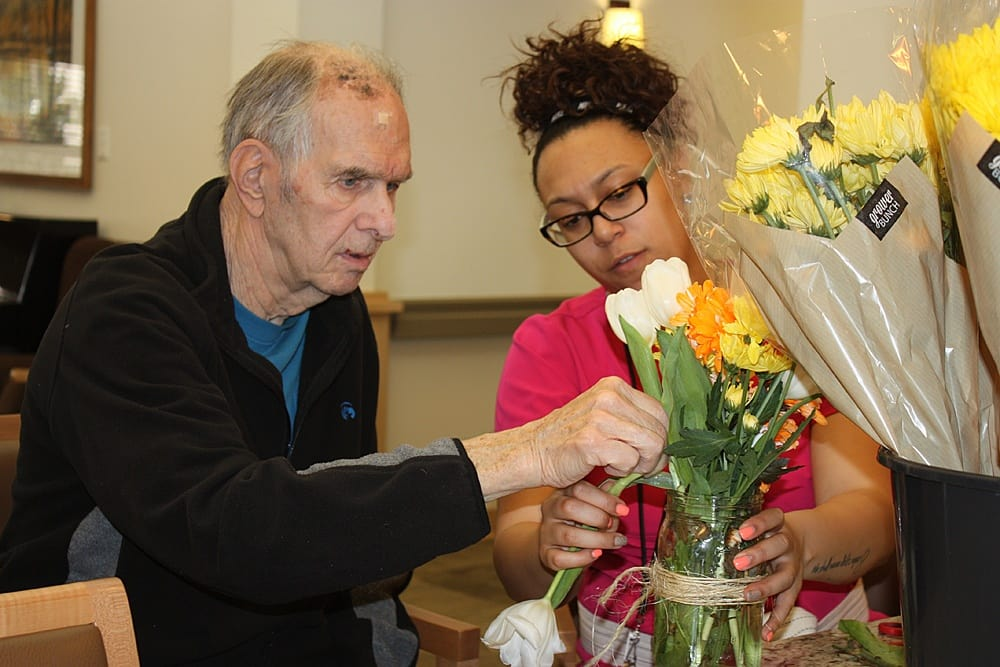 Patient helping with flowers at Morningside Place