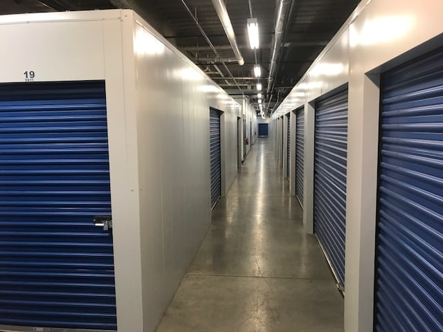Indoor storage units at Highway 10 Storage with blue doors