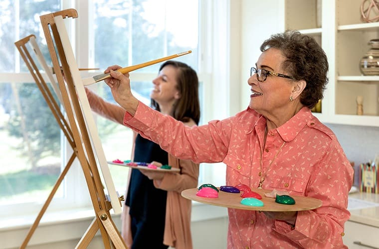 A resident doing artwork at one of our Maplewood Senior Living communities.