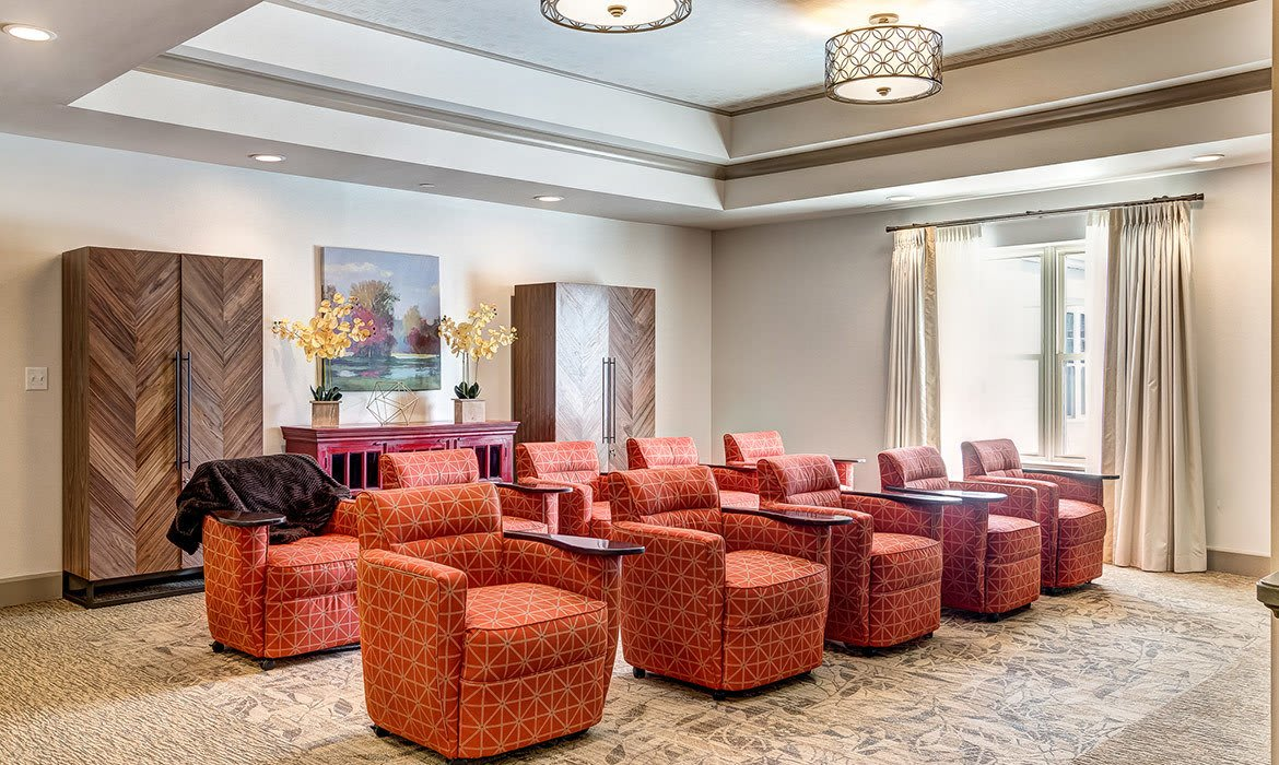 The movie theater at Maplewood at Cuyahoga Falls welcomes residents and their guests with lavish comfort.