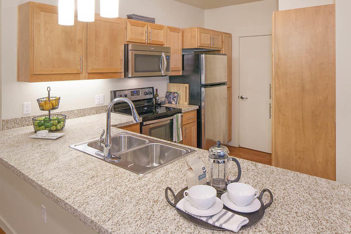 Kitchen With Granite Countertop At Eddyline at Bridgeport In Portland