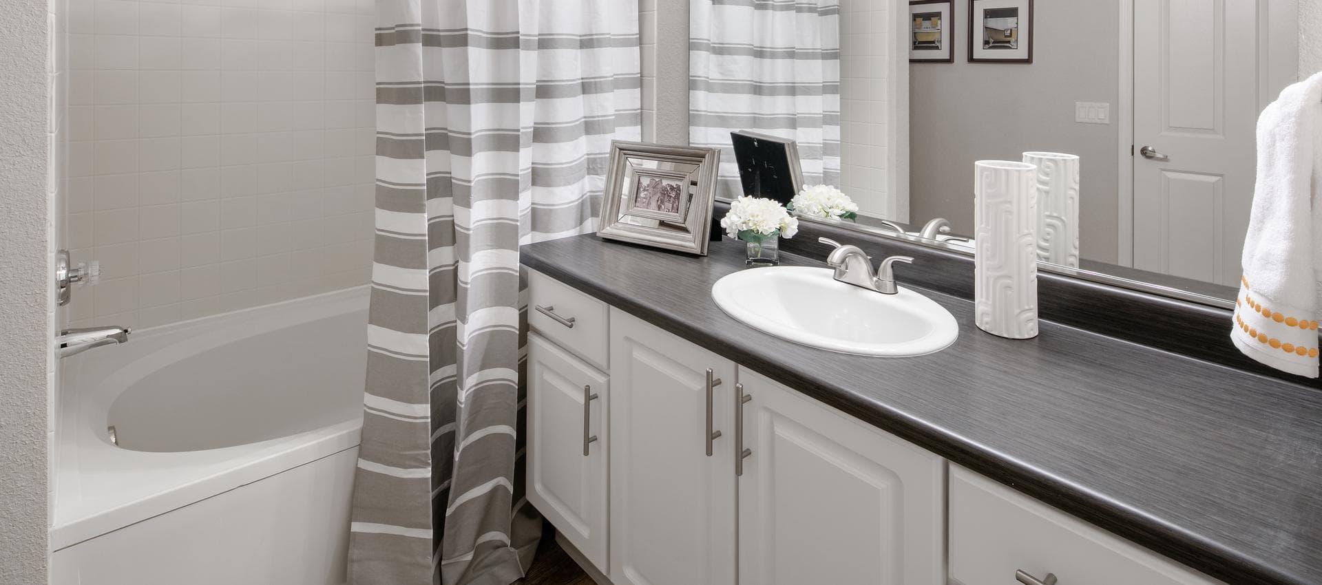 The Artisan Apartment Homes's Spacious Bathroom in Sacramento, CA