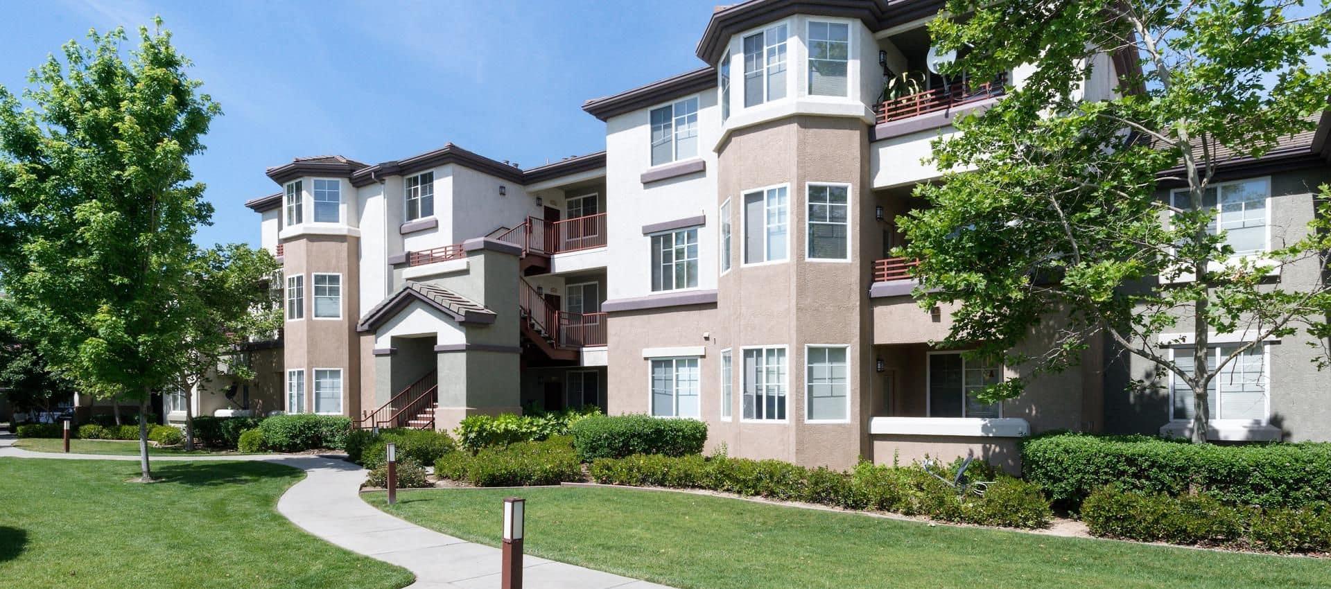 The Artisan Apartment Homes's Walking Path Through Apartments in Sacramento, CA