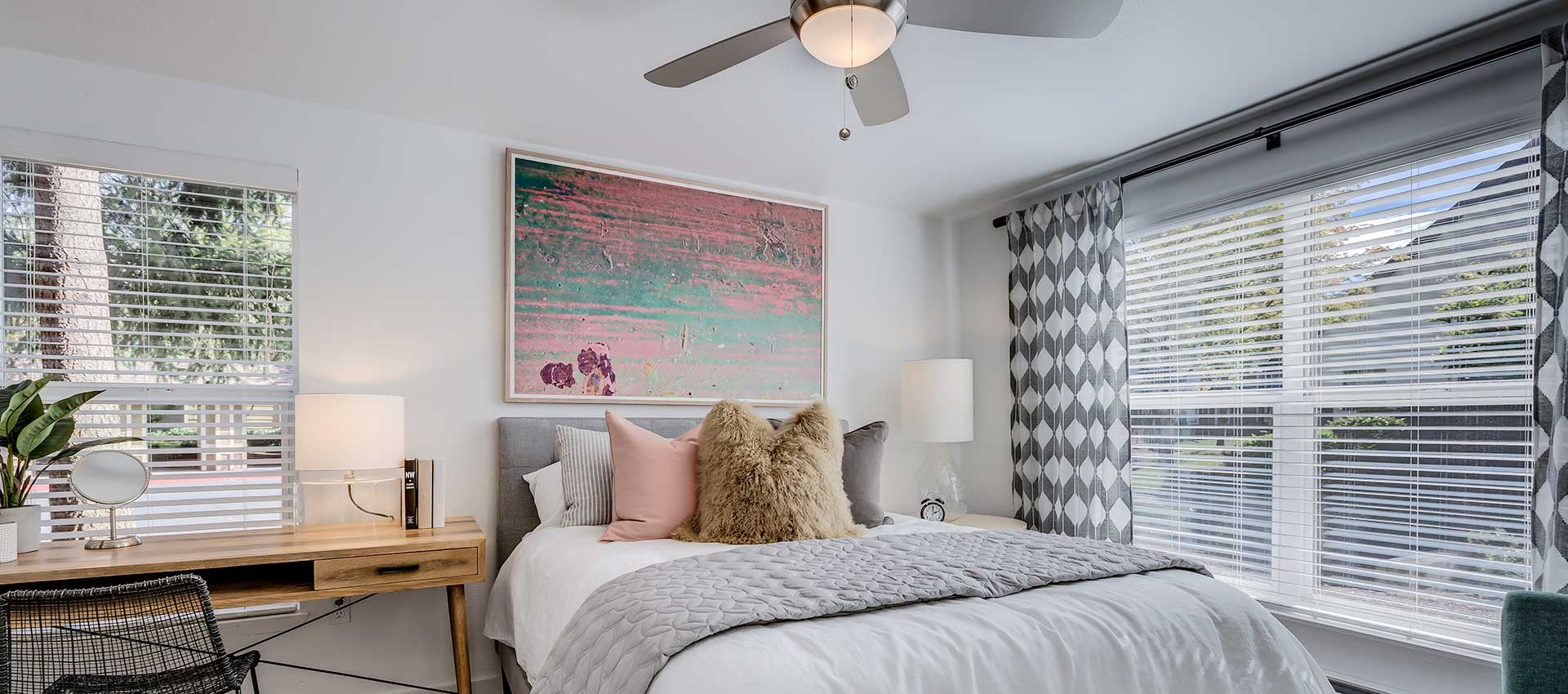 Master bedroom with fan at Centro Apartment Homes in Hillsboro, Oregon