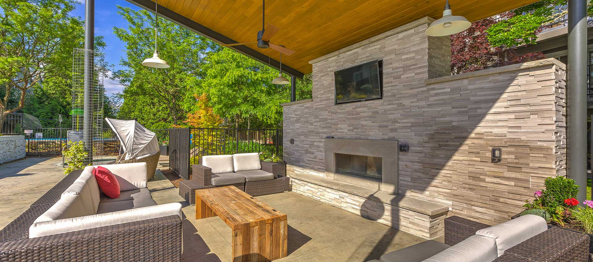 Poolside pavilion with fireside seating at Centro Apartment Homes