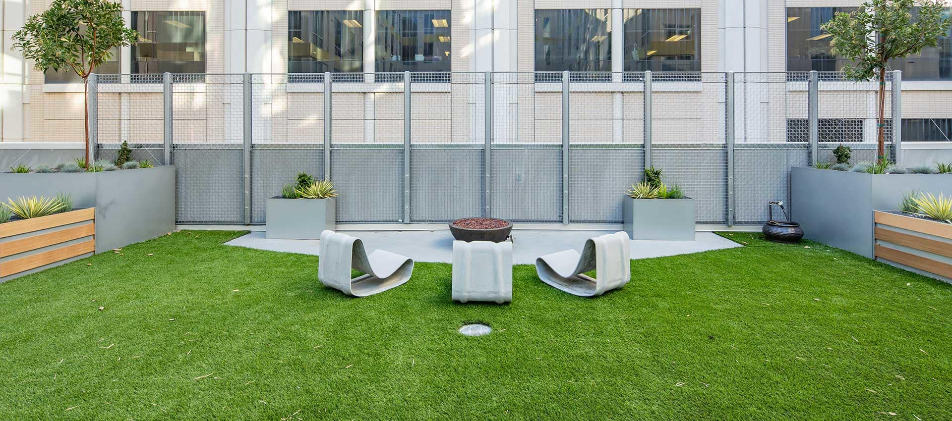 Fire pit in the EVIVA Midtown courtyard