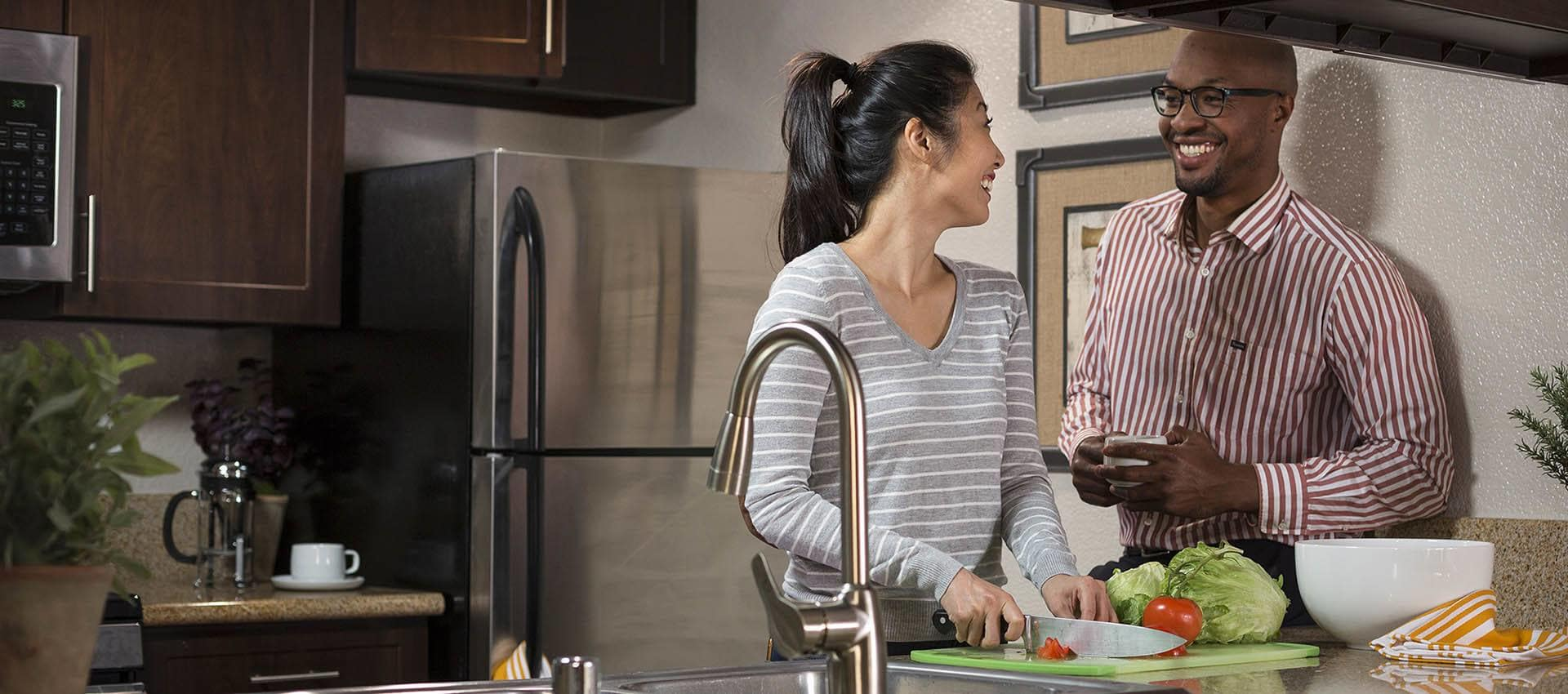 Couple in the kitchen at Reserve at Capital Center Apartment Homes in Rancho Cordova, California