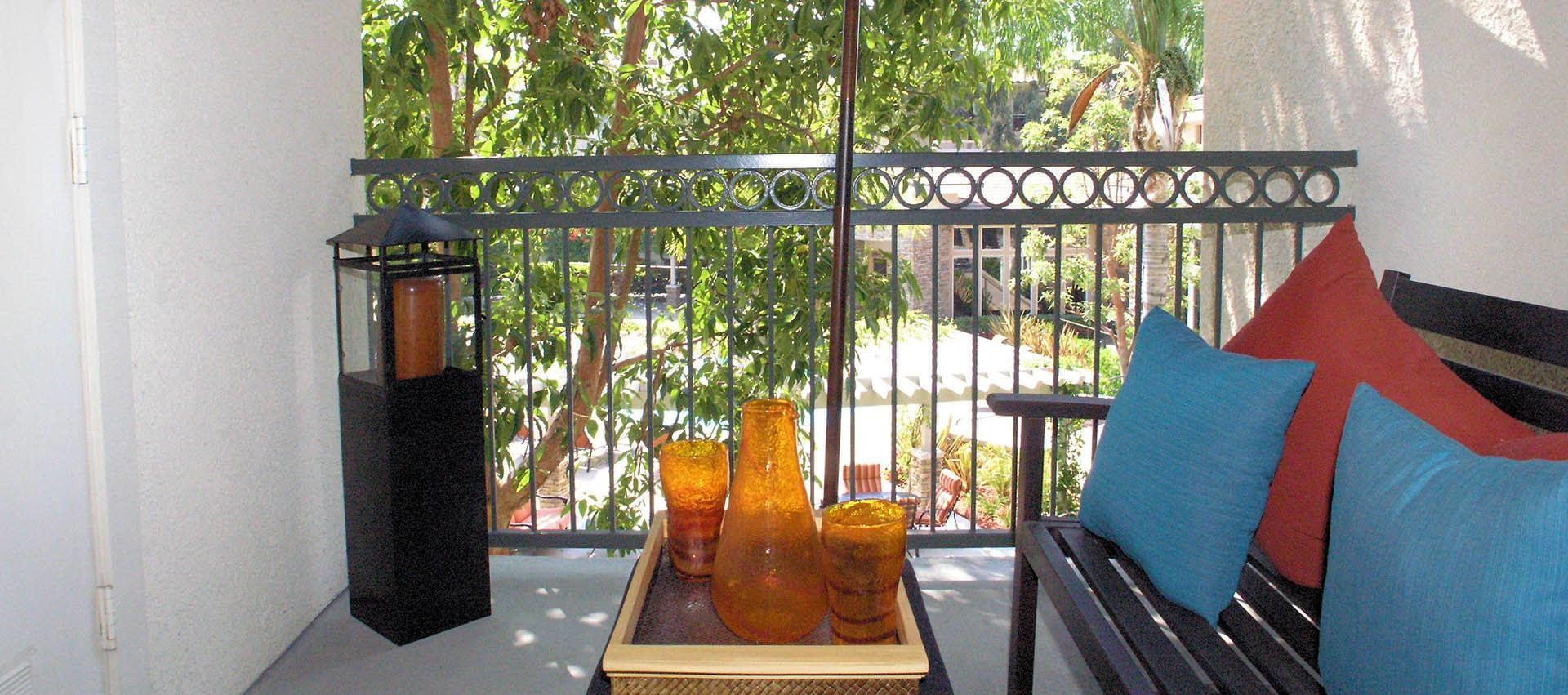 Balcony Seating Area in Alize at Aliso Viejo Apartment Homes in Aliso Viejo, California
