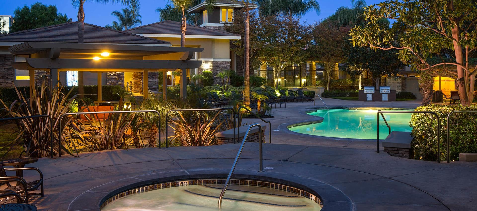 Hot Tub And Pool At Night in Alize at Aliso Viejo Apartment Homes in Aliso Viejo, California