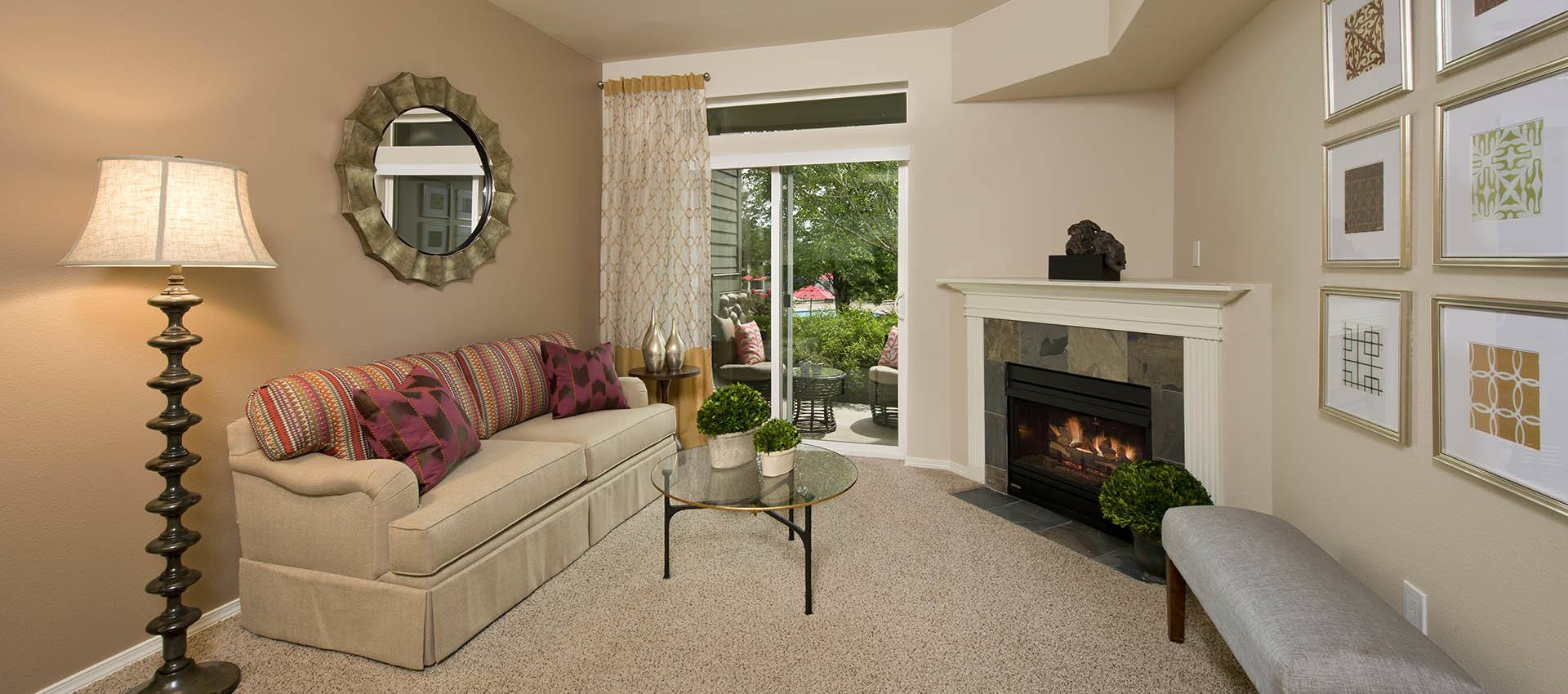 Living Room With Fireplace at Altamont Summit in Happy Valley, OR