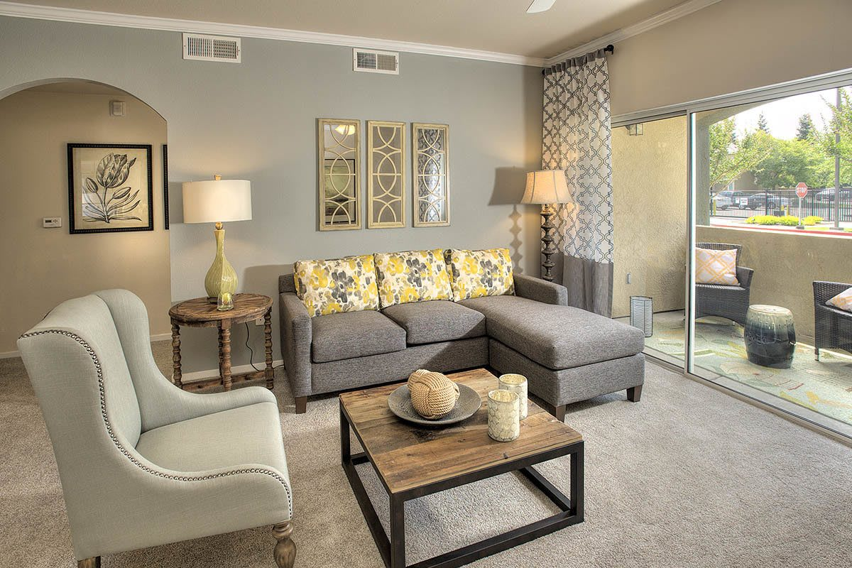 Living Area With Deck Access at Cross Pointe Apartment Homes in Antioch