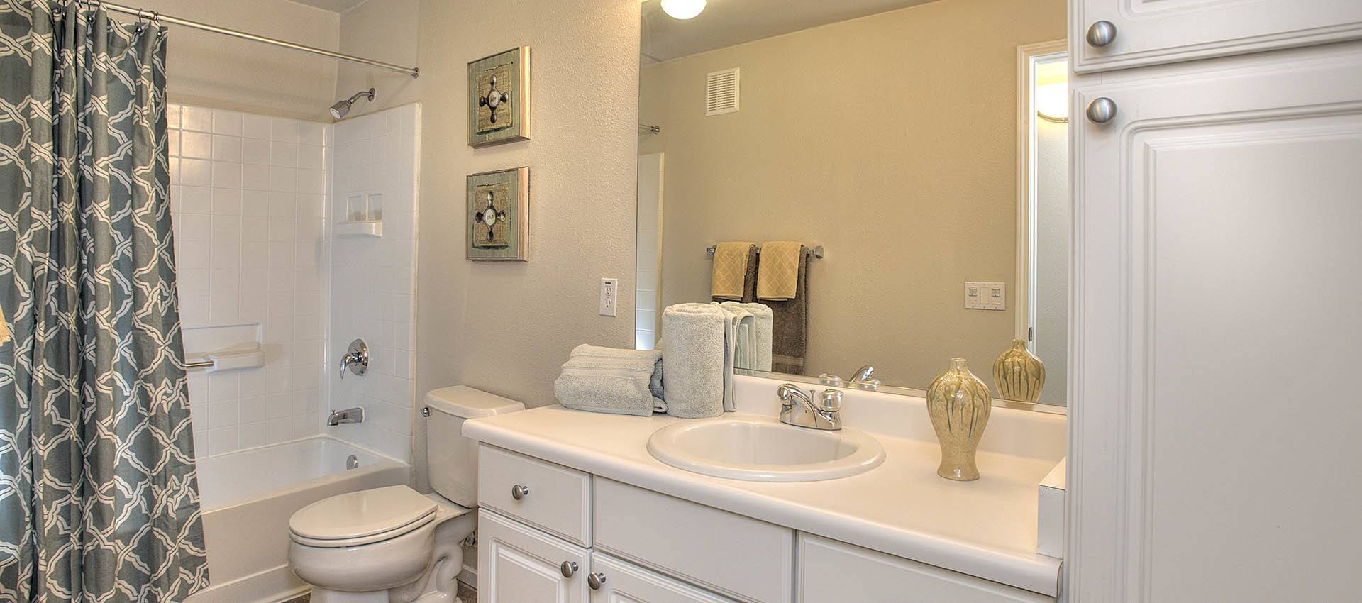 Bathroom with white cabinets at Cross Pointe Apartment Homes in Antioch