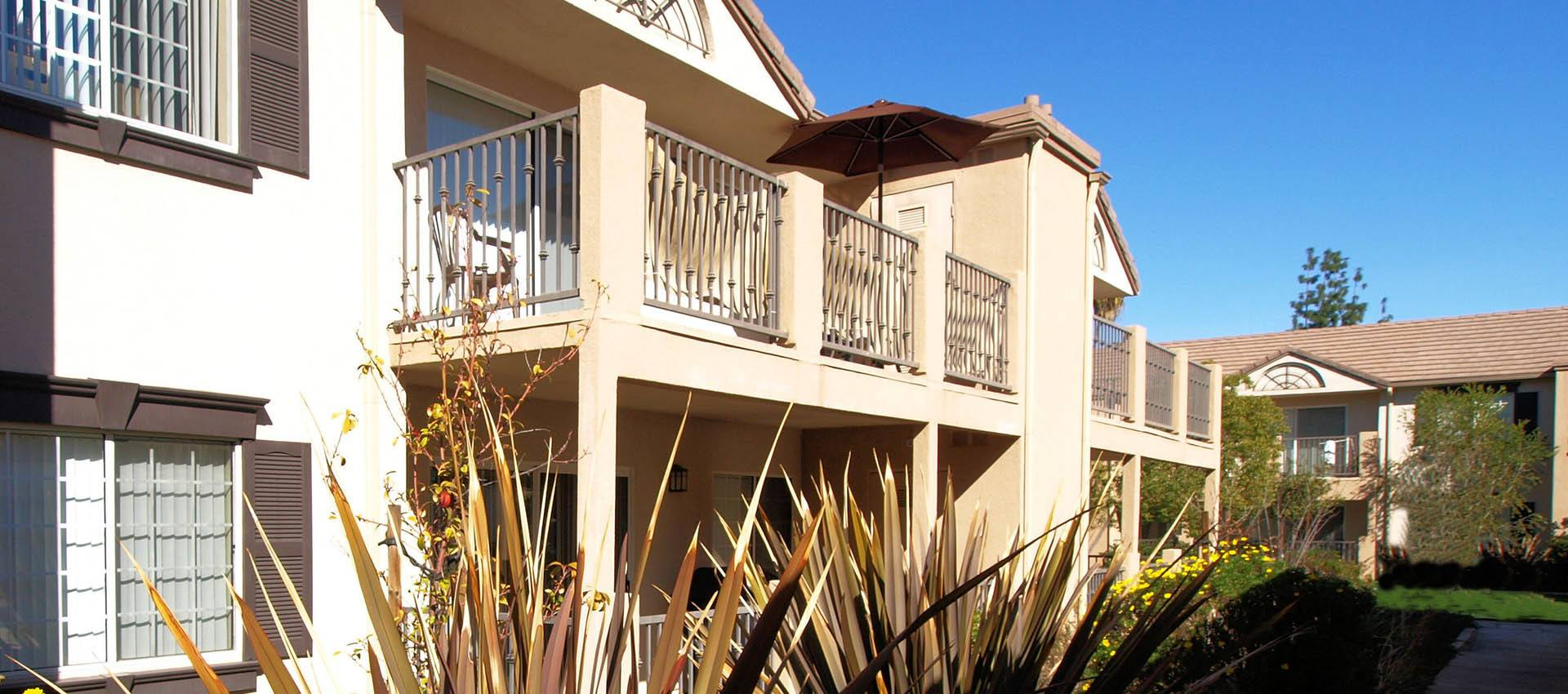 Building Exterior With Balconies at Cypress Villas Apartment Homes in Redlands, CA