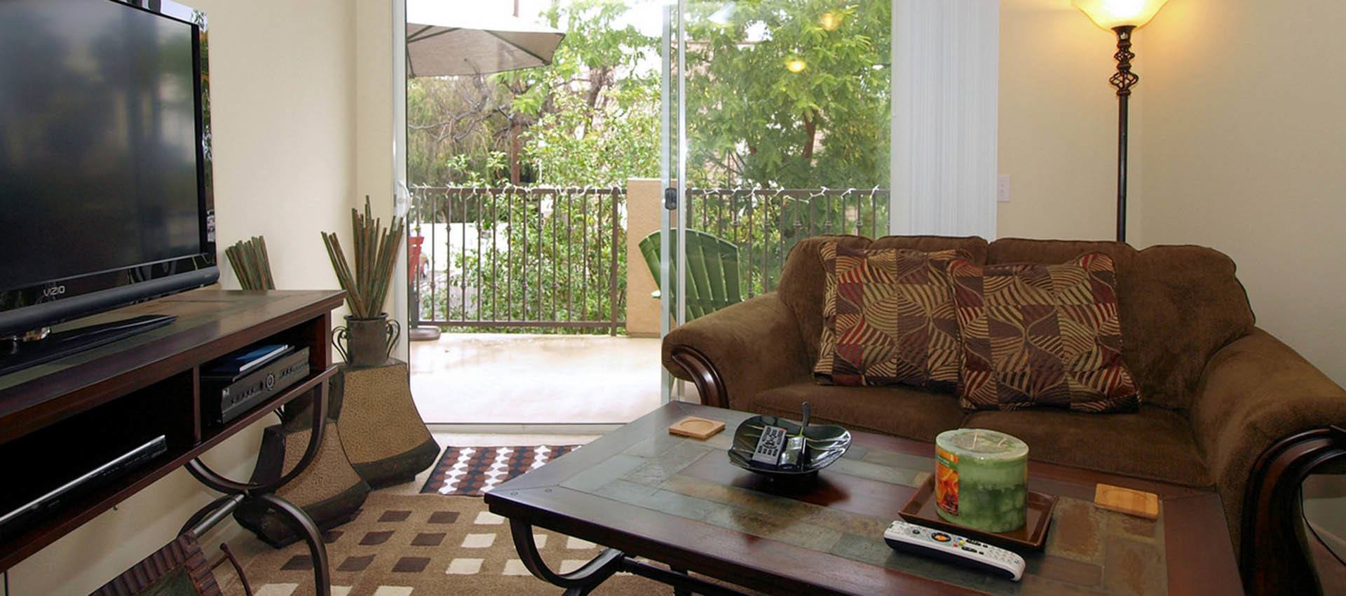 Living Room With Balcony at Cypress Villas Apartment Homes in Redlands, CA