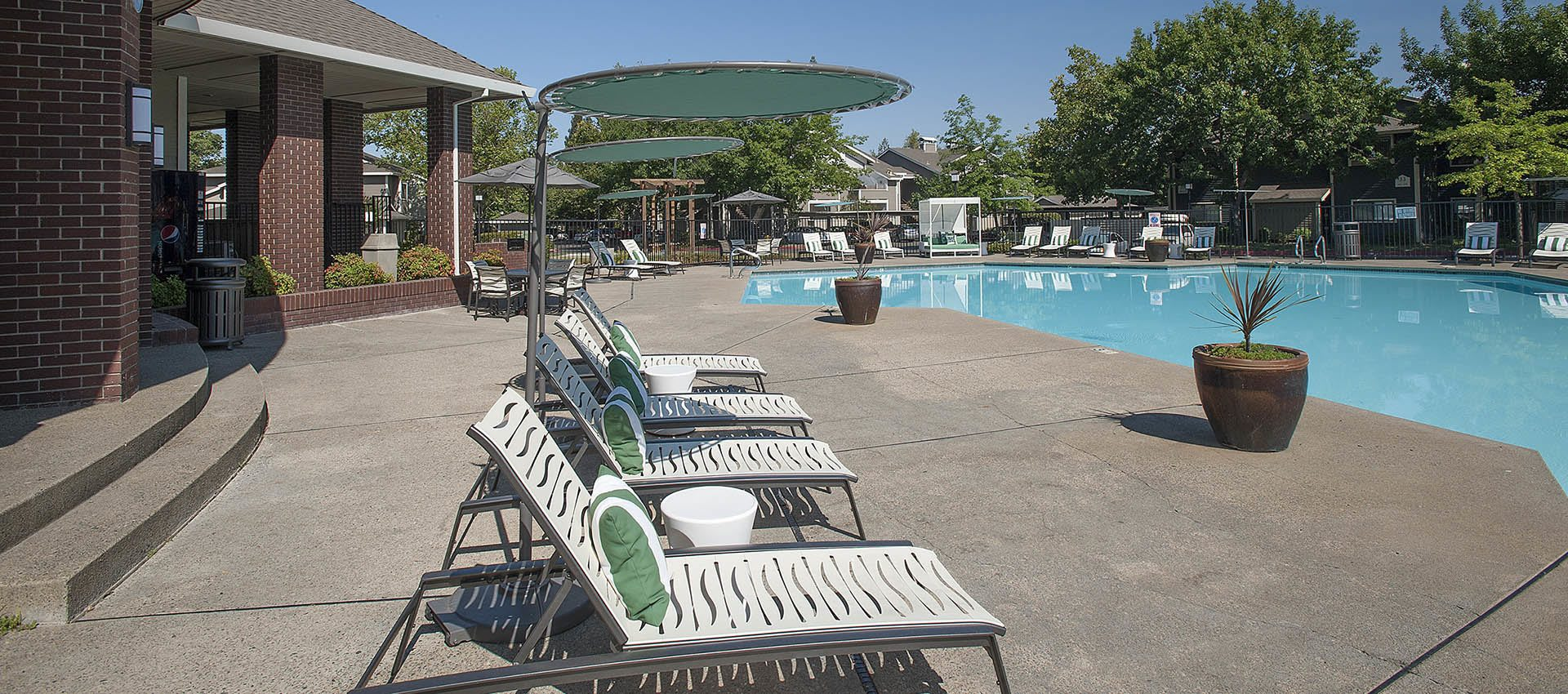 Sunchairs Near Swimming Pool at Deer Valley Apartment Homes in Roseville, California