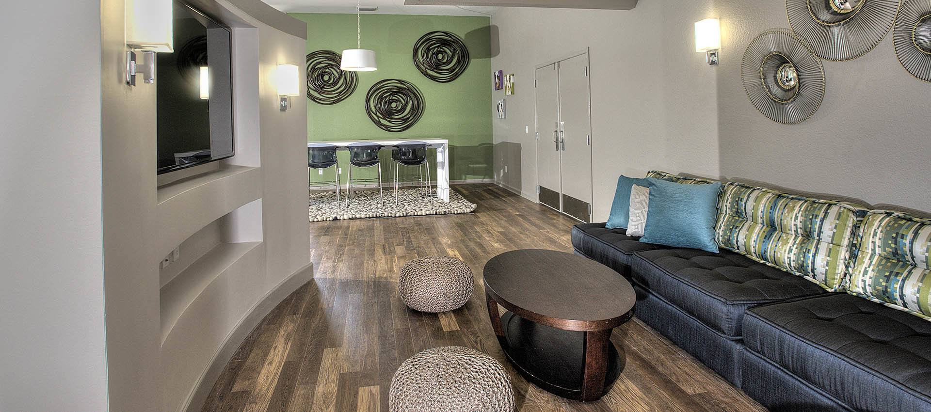 Tv Seating Area In Clubhouse at Deer Valley Apartment Homes in Roseville, California
