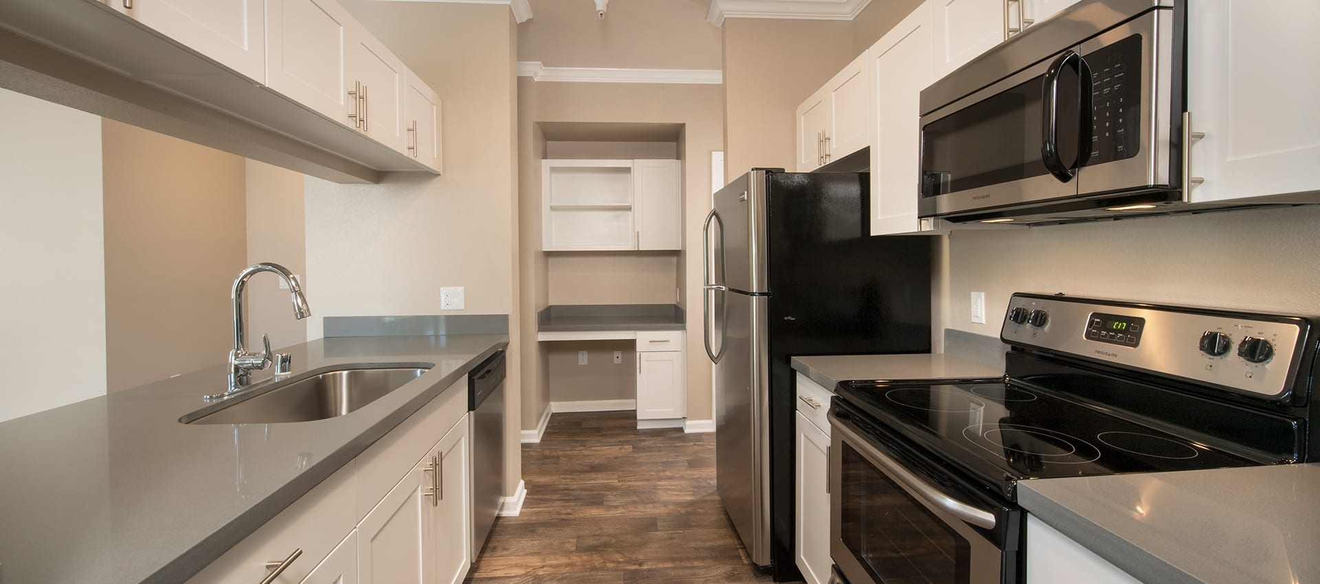 Modern kitchen with stainless-steel appliances at Esplanade Apartment Homes in Riverside, California