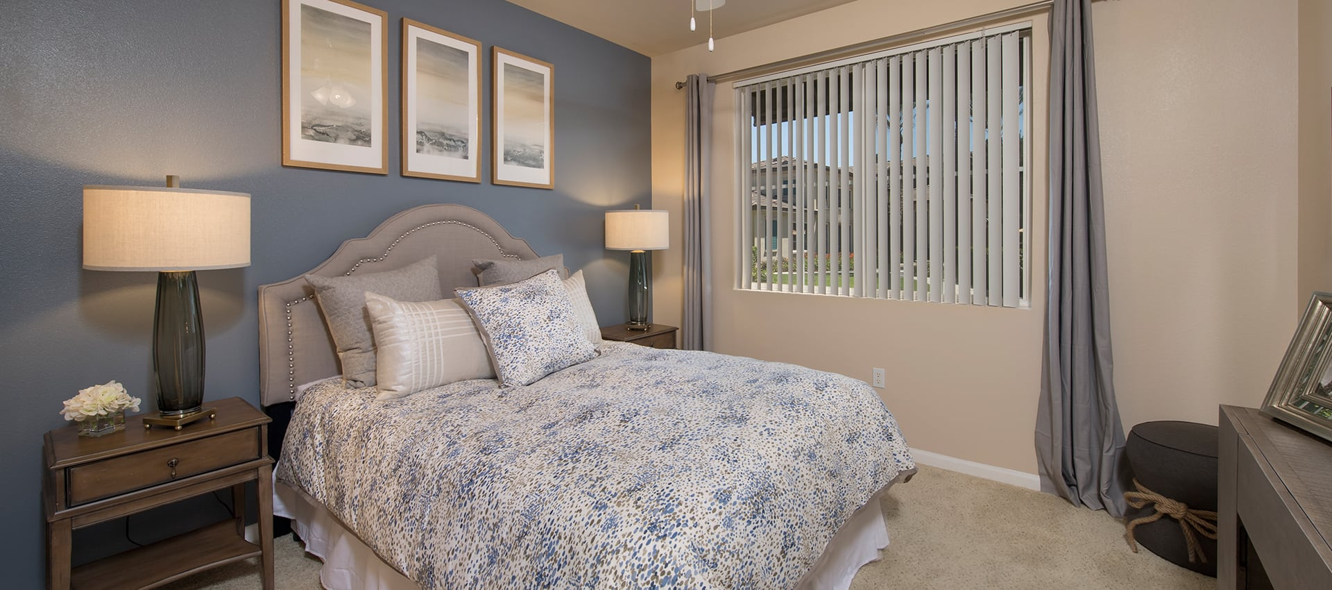 Model bedroom featuring bed at Esplanade Apartment Homes in Riverside, California