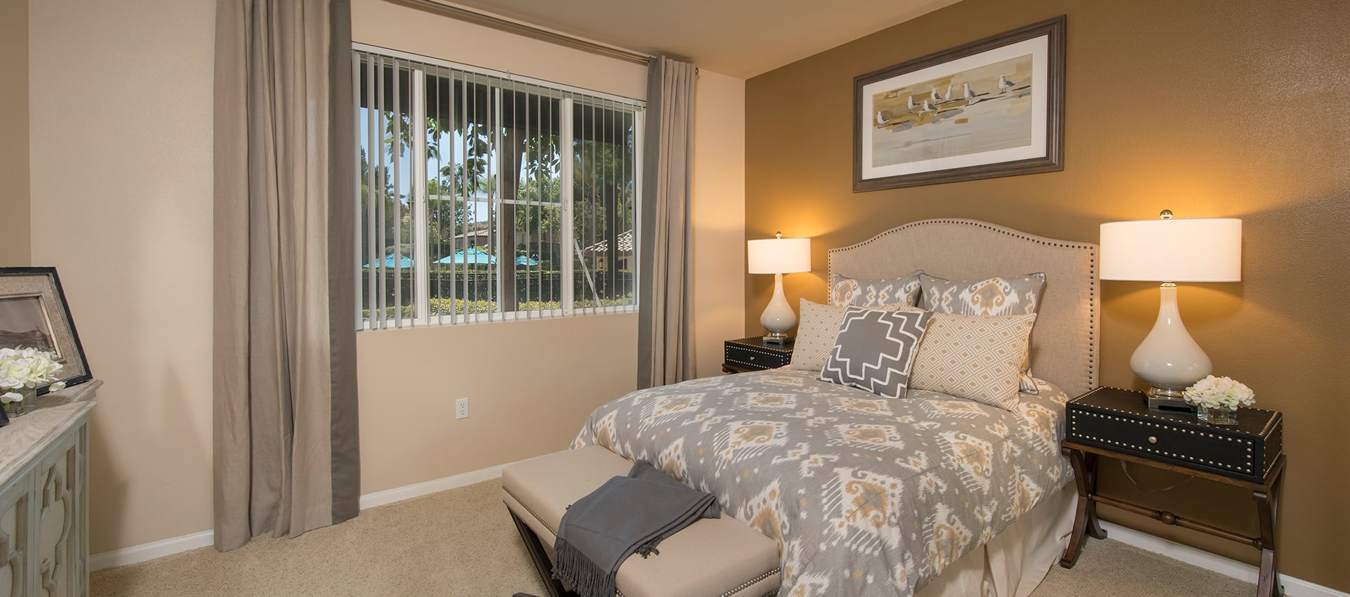 Model bedroom with unique accent lighting at Esplanade Apartment Homes in Riverside, California