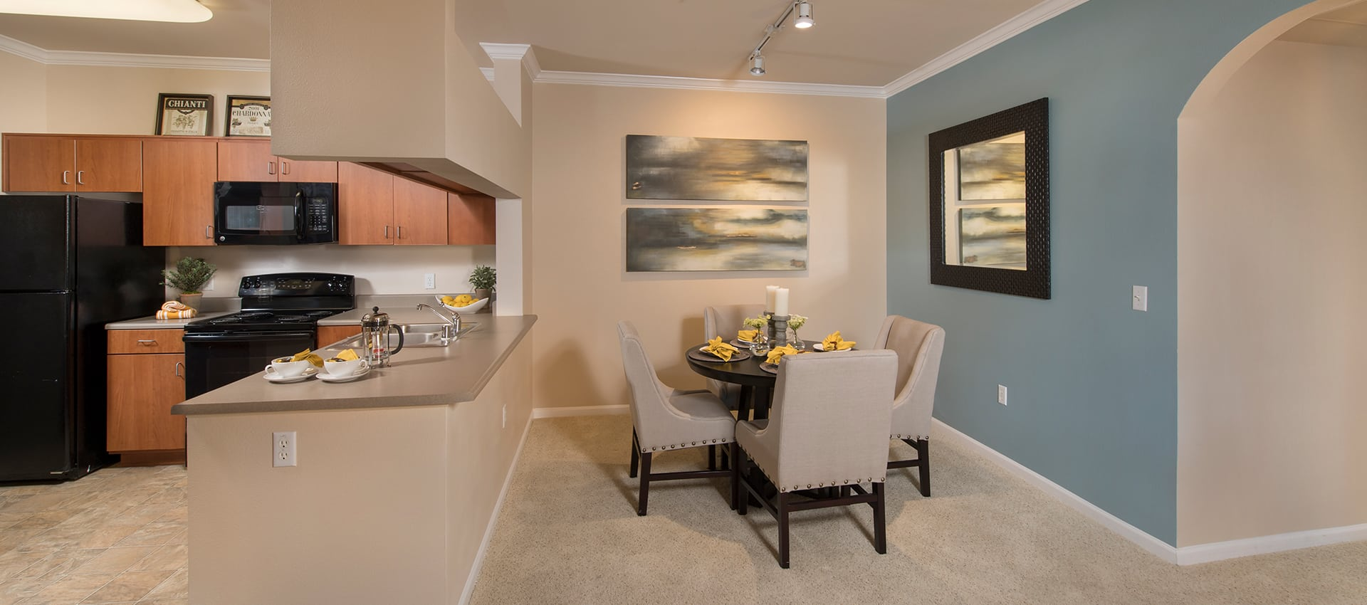 Kitchen and dining room at Esplanade Apartment Homes in Riverside, California