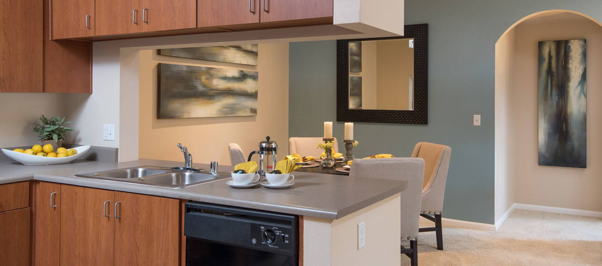 State-of-the-art kitchen with wooden cabinetry at Esplanade Apartment Homes in Riverside, California