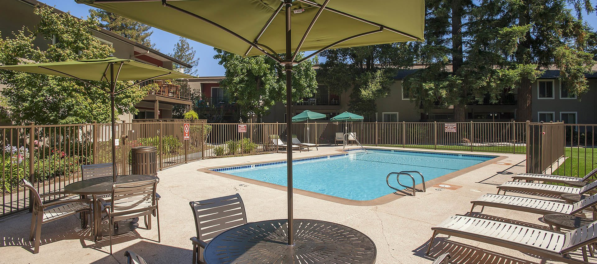 Covered Picnic Tables By The Pool at Flora Condominium Rentals in Walnut Creek, California
