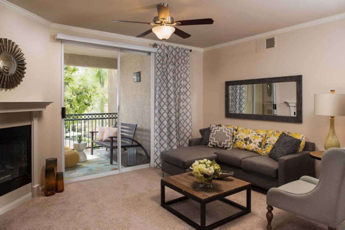 Spacious Living Room With Balcony at Hidden Hills Condominium Rentals