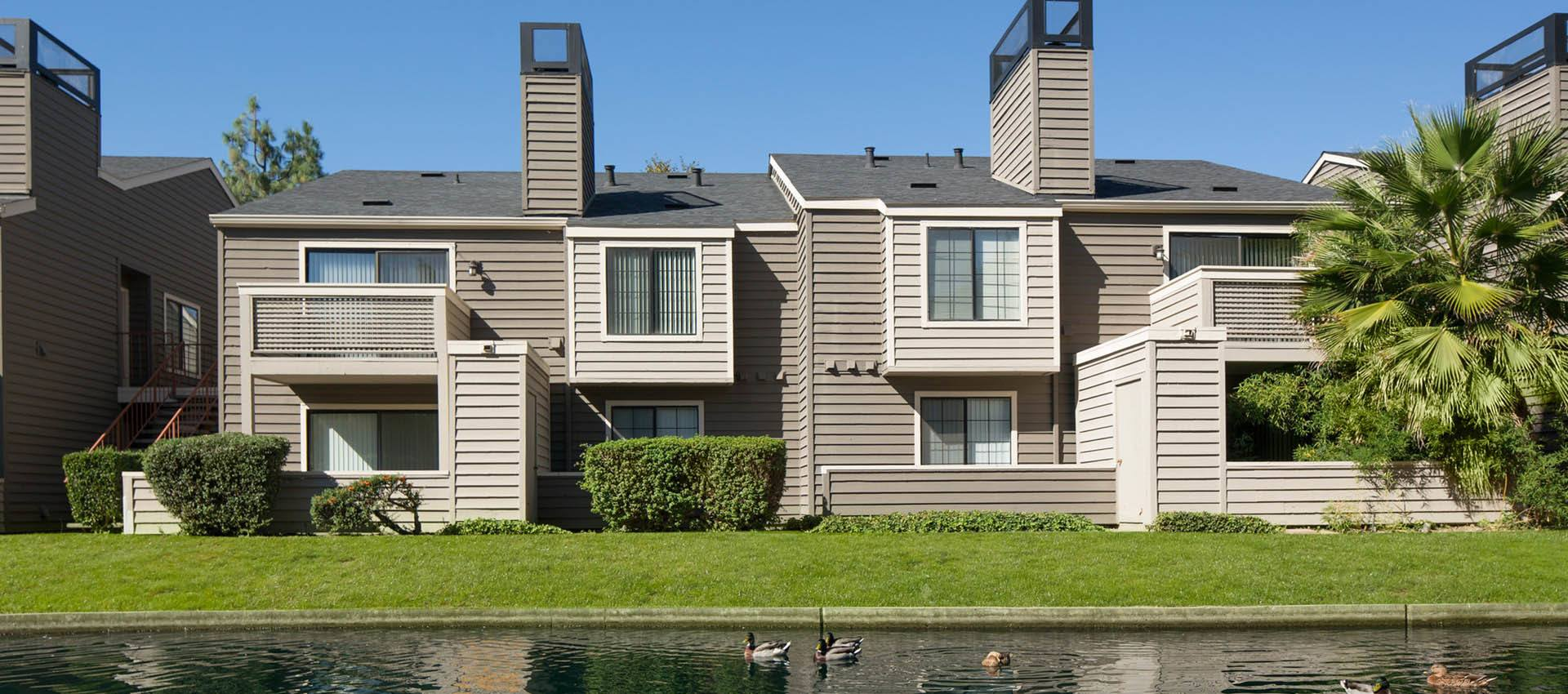Condo Exterior Near Waterfront at Hidden Lake Condominium Rentals in Sacramento, CA