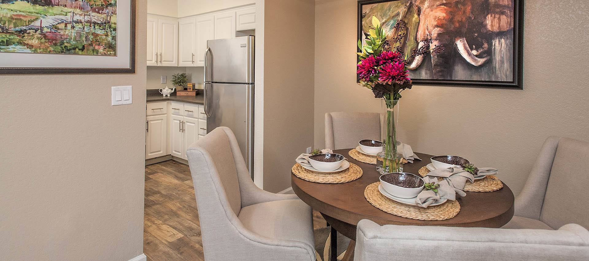 Dining Area With Kitchen View at Hidden Lake Condominium Rentals in Sacramento, CA