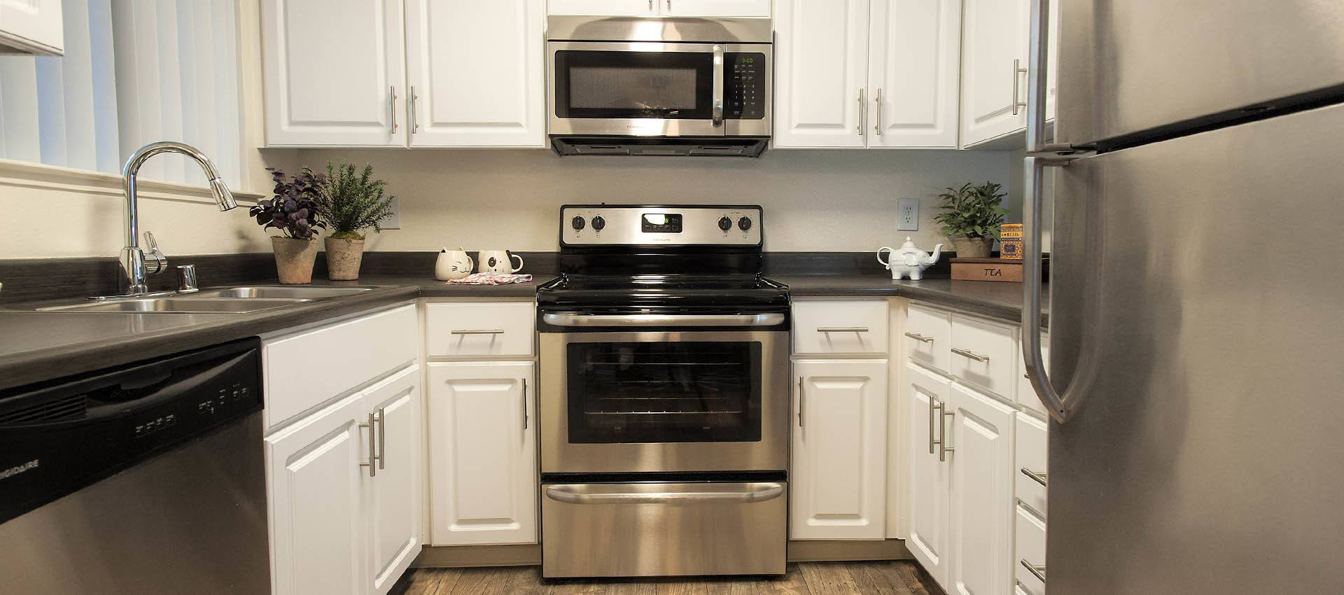 Kitchen With Stainless Appliances at Hidden Lake Condominium Rentals in Sacramento, CA