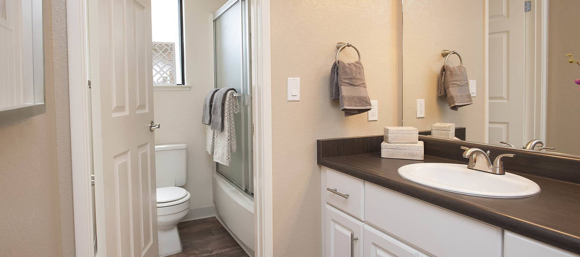 Large Bathroom With Private Shower And Commode at Hidden Lake Condominium Rentals in Sacramento, California