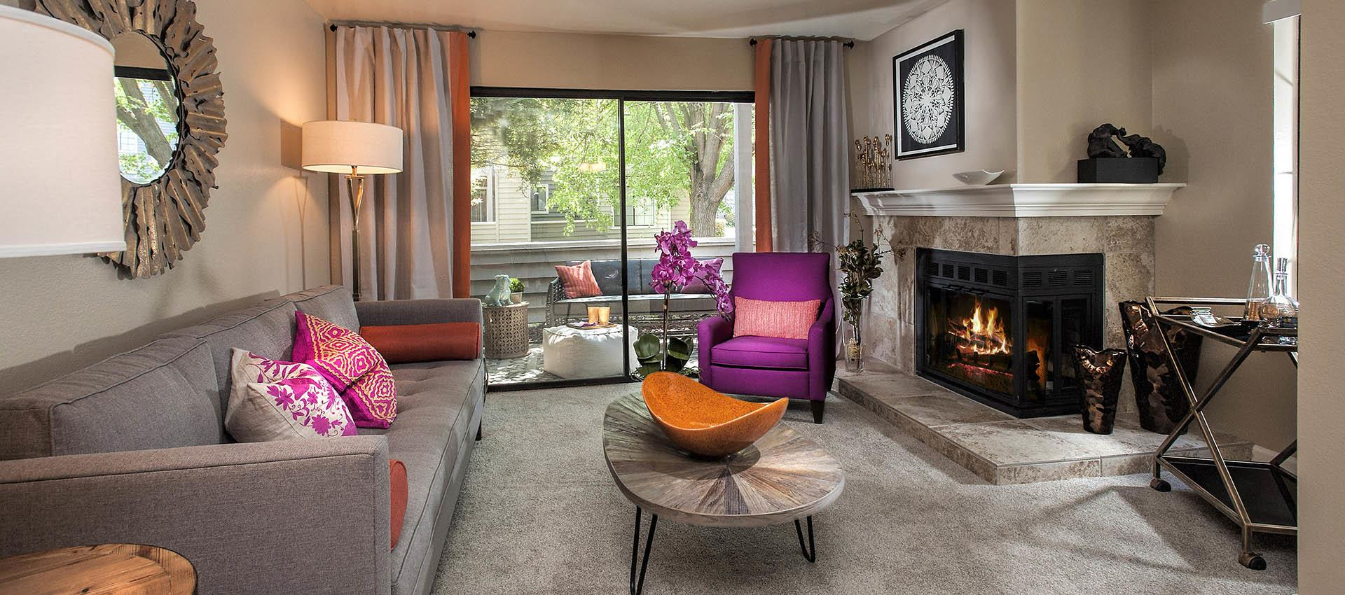 Living Room With Modern Decor And Fire Place at Hidden Lake Condominium Rentals in Sacramento, CA