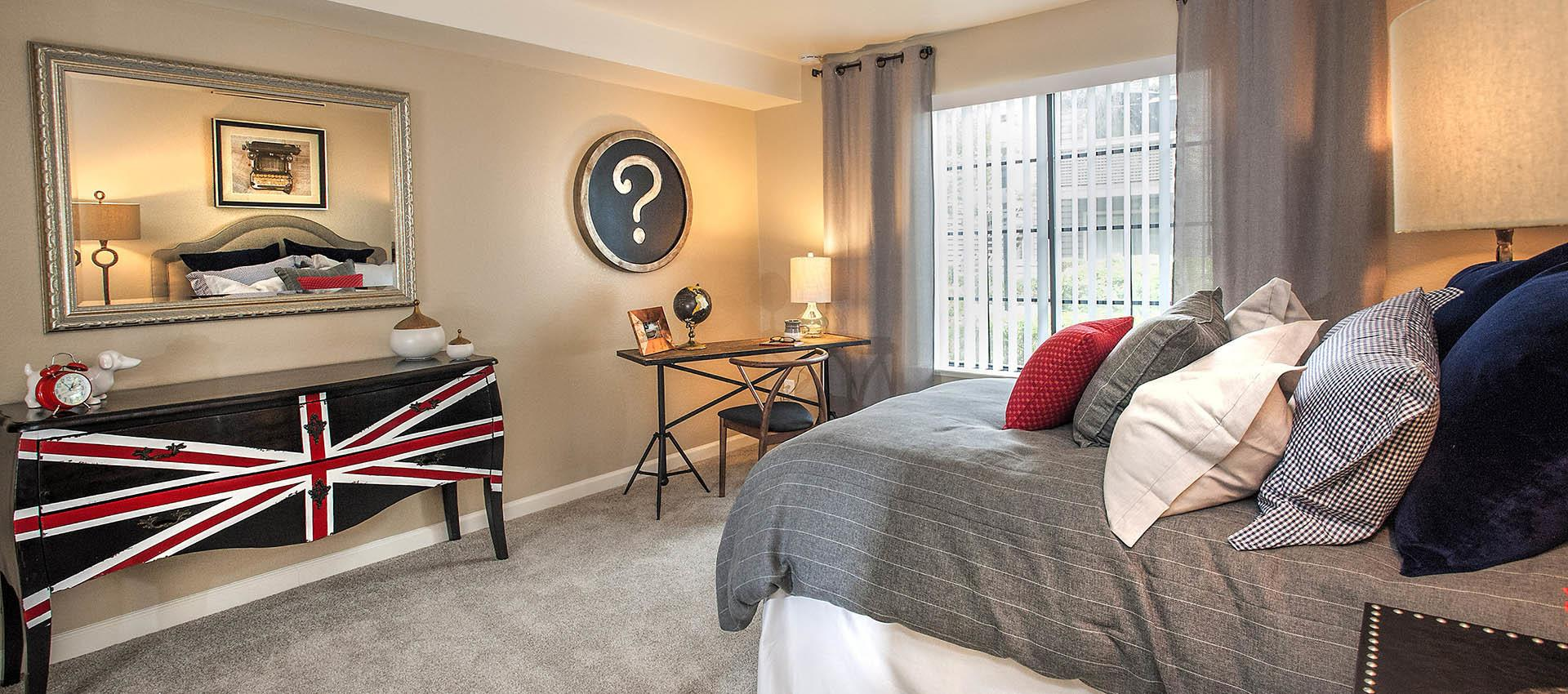 Spacious Master Bedroom With Modern Decorations at Hidden Lake Condominium Rentals in Sacramento, California