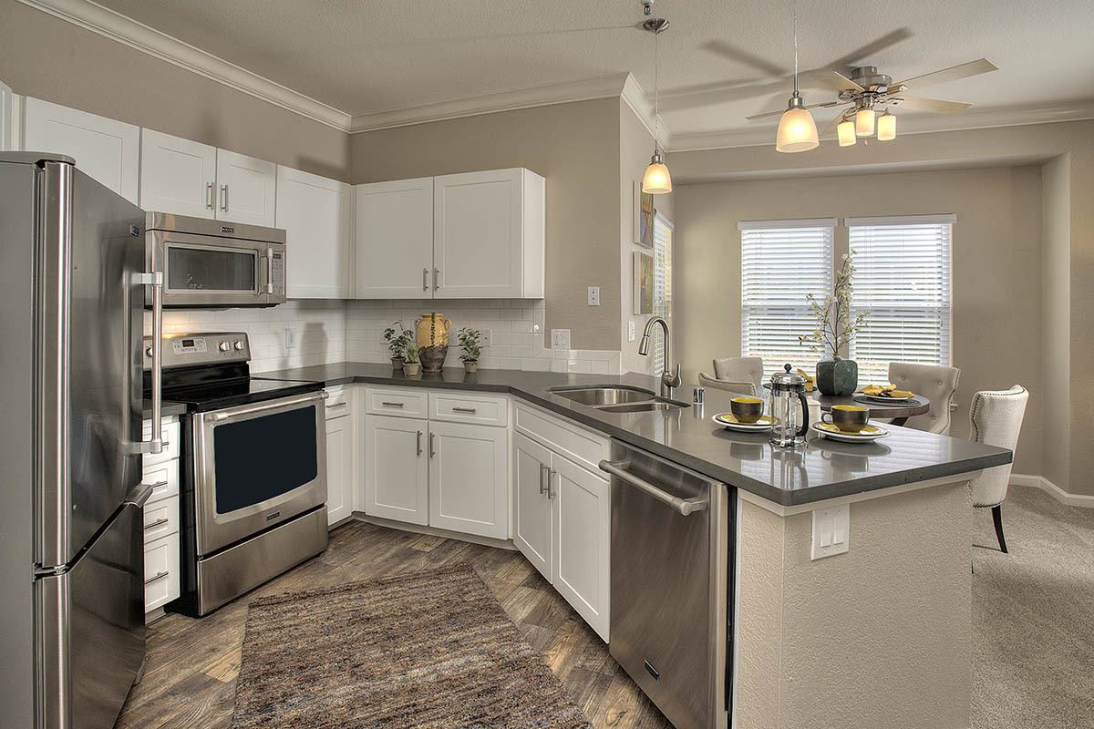 Kitchen With Stainless Appliances at Iron Point at Prairie Oaks