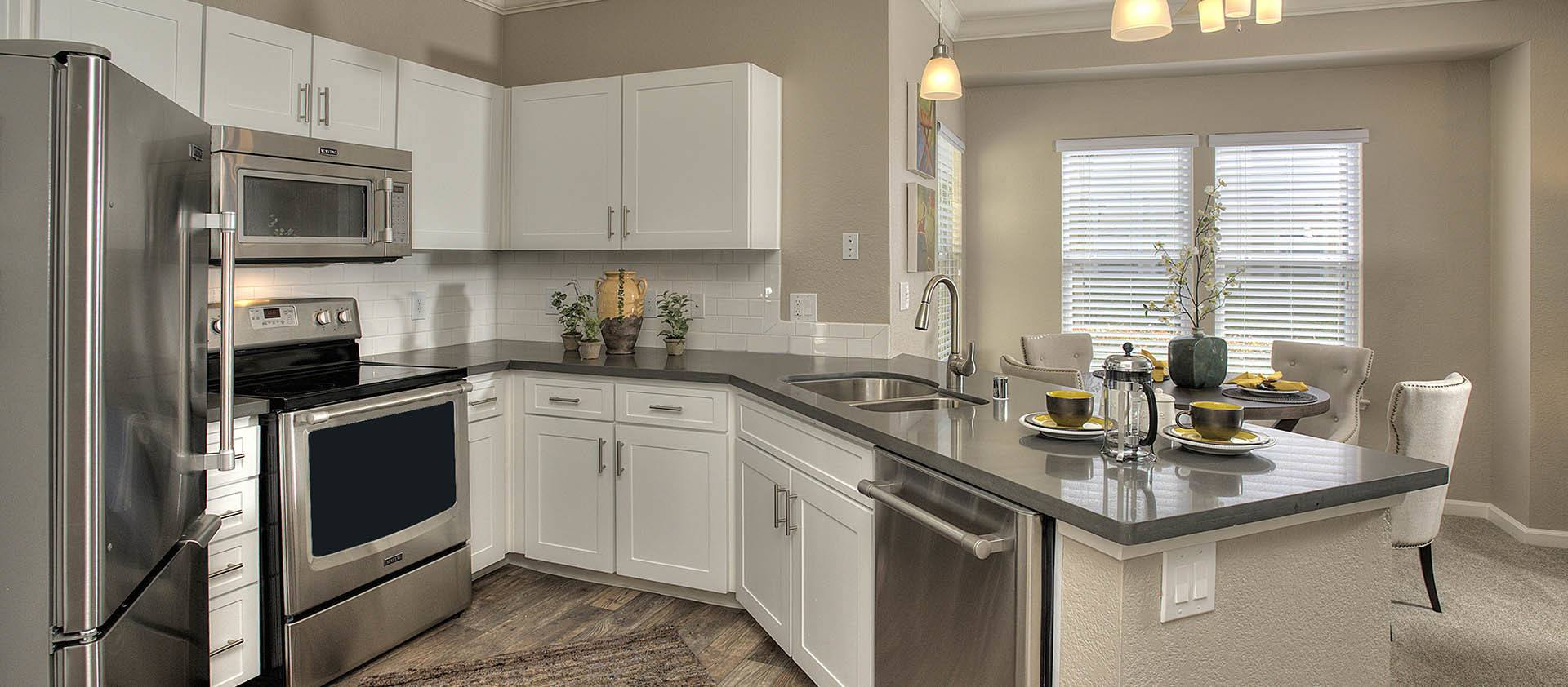 Kitchen With Stainless Appliances at Iron Point at Prairie Oaks in Folsom, California