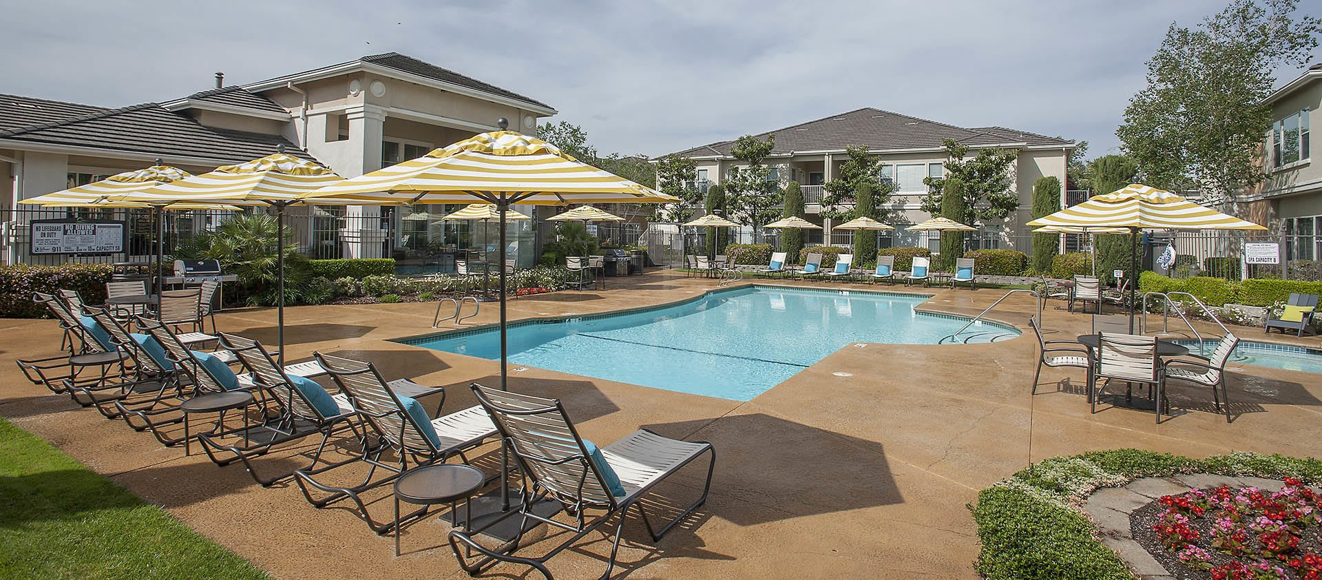 Outdoor seating by pool at Iron Point at Prairie Oaks in Folsom, California