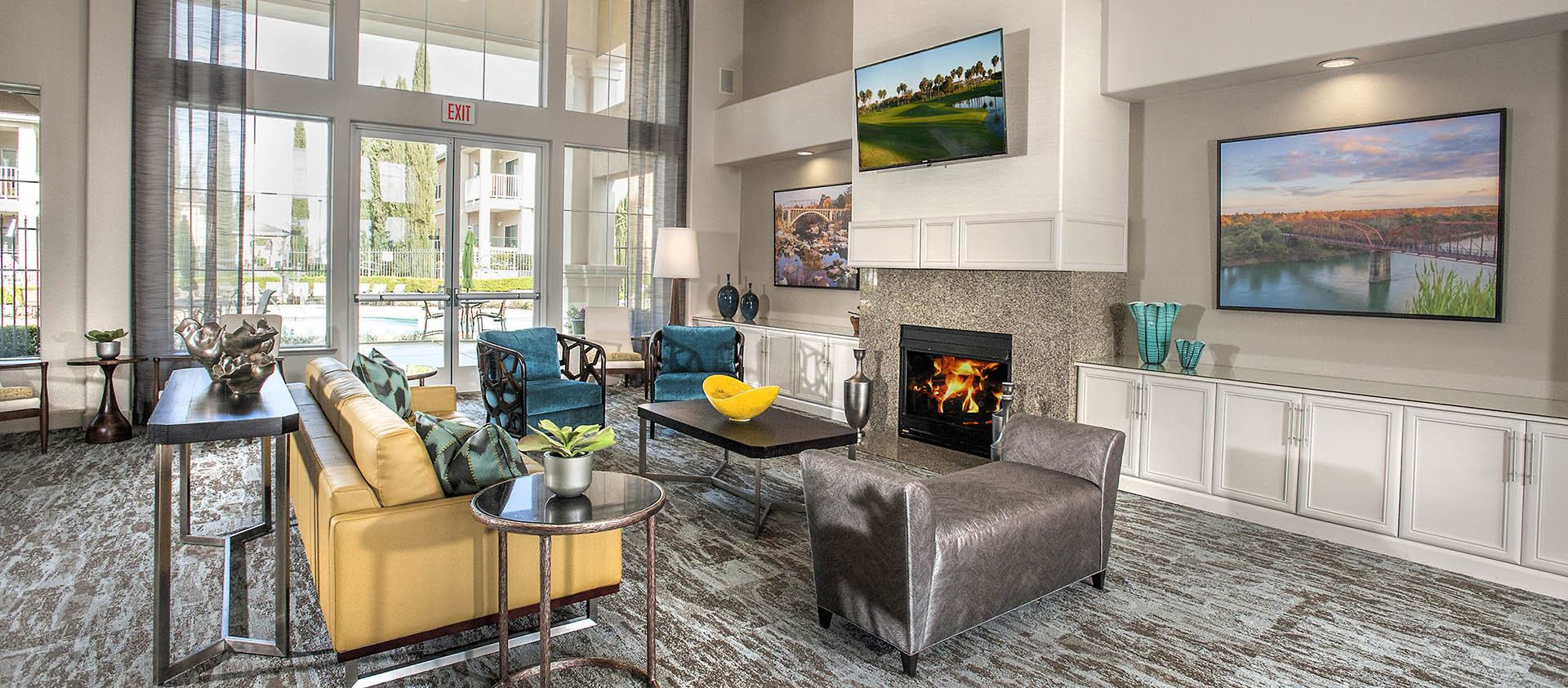 Tv Seating Area In Clubhouse at Iron Point at Prairie Oaks in Folsom, California