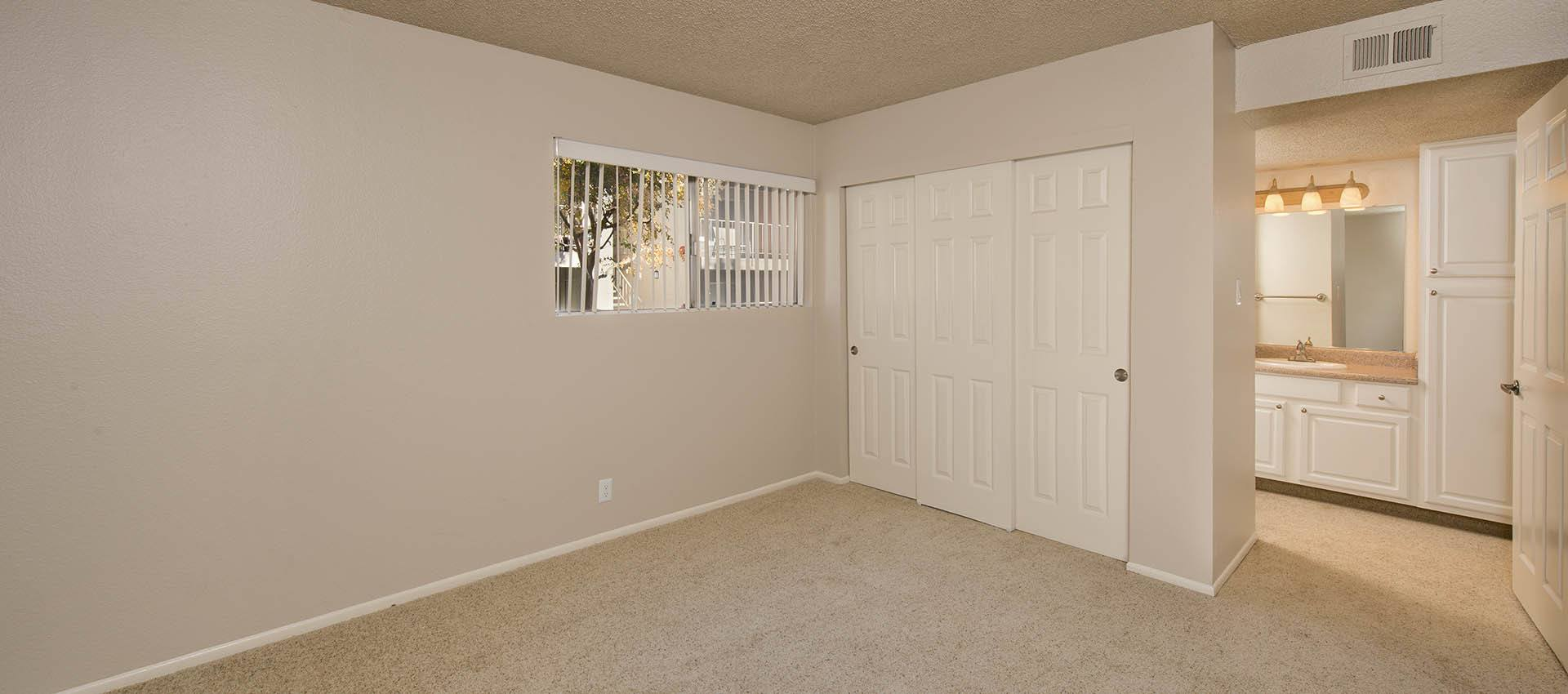Living Room With Closet at La Valencia Apartment Homes in Campbell, California