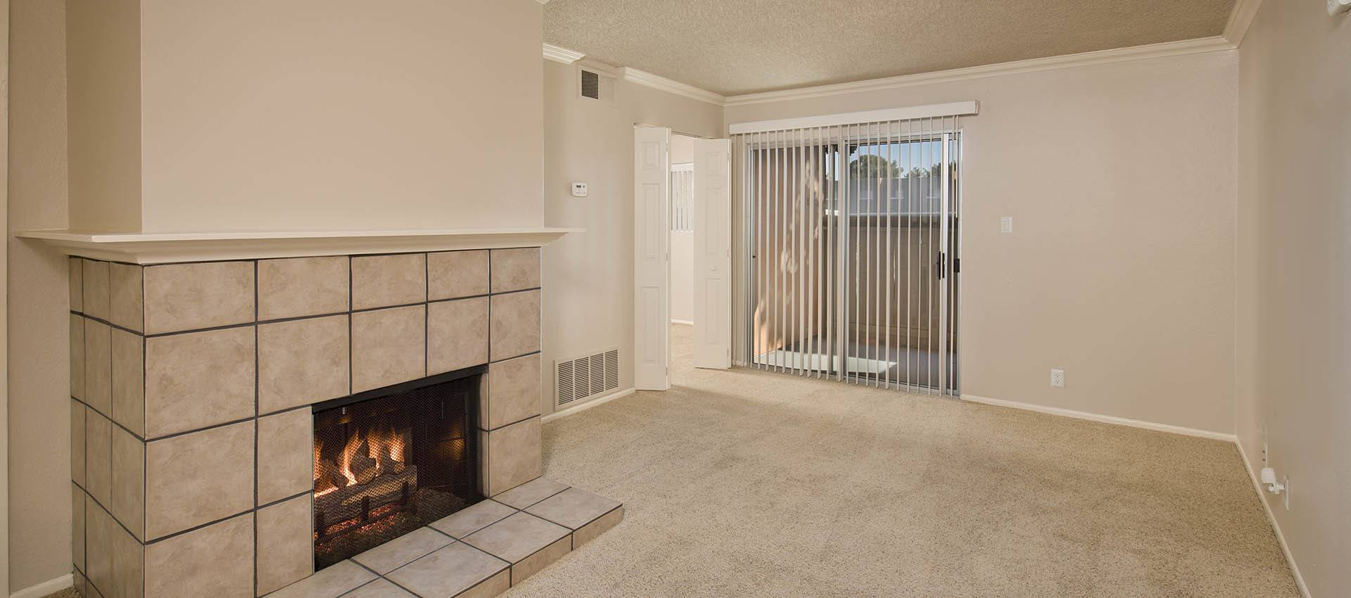 Living Room With Fireplace at La Valencia Apartment Homes in Campbell, California