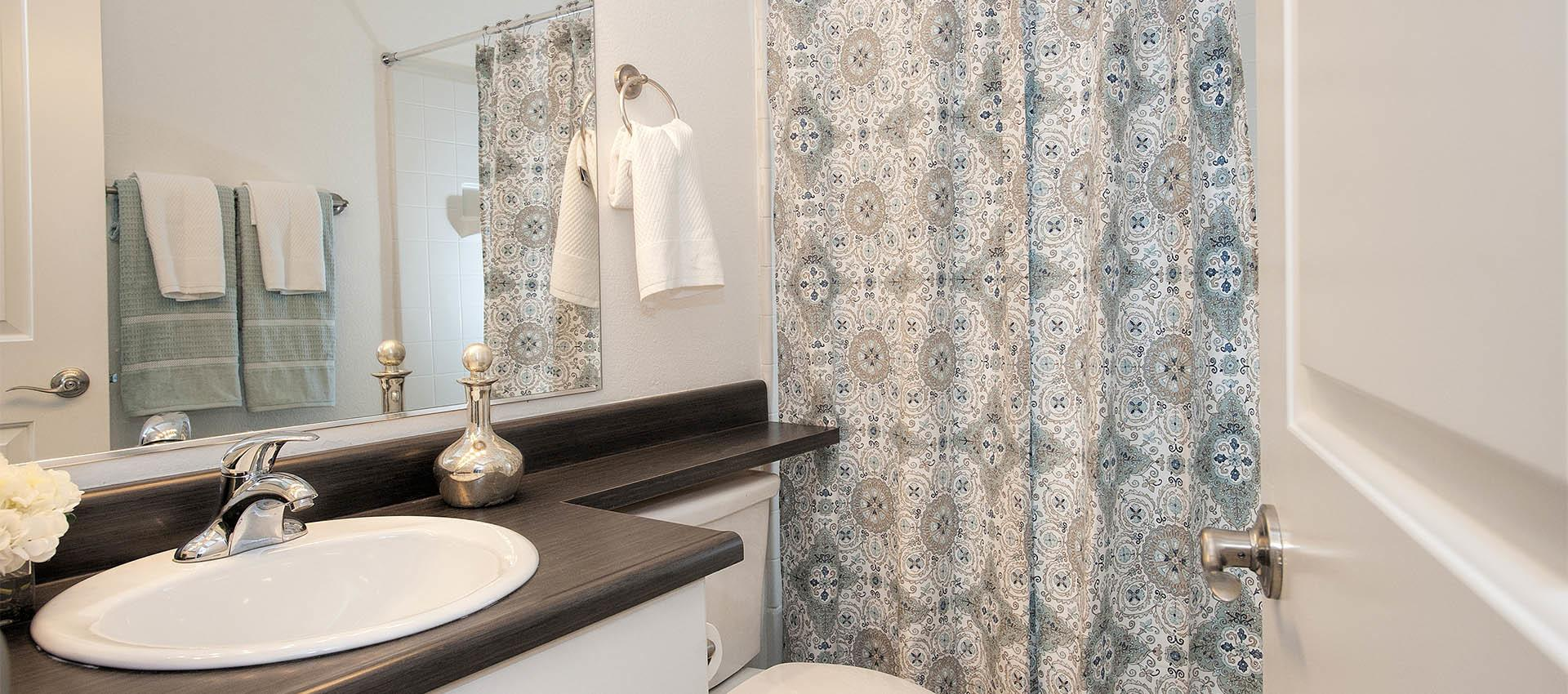 Bright Bathrooms at Mill Springs Park Apartment Homes in Livermore
