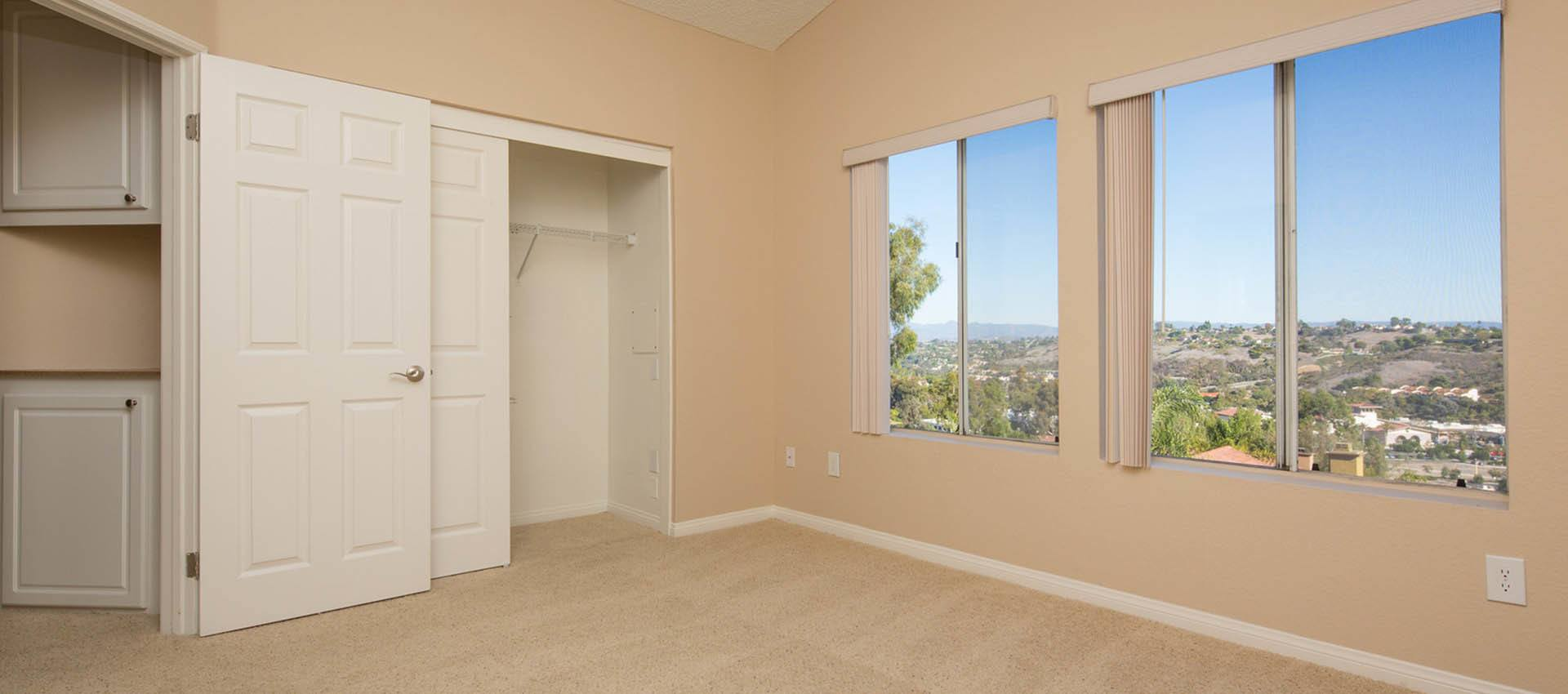 Bedroom With Large Windows at Niguel Summit Condominium Rentals in Laguna Niguel, CA