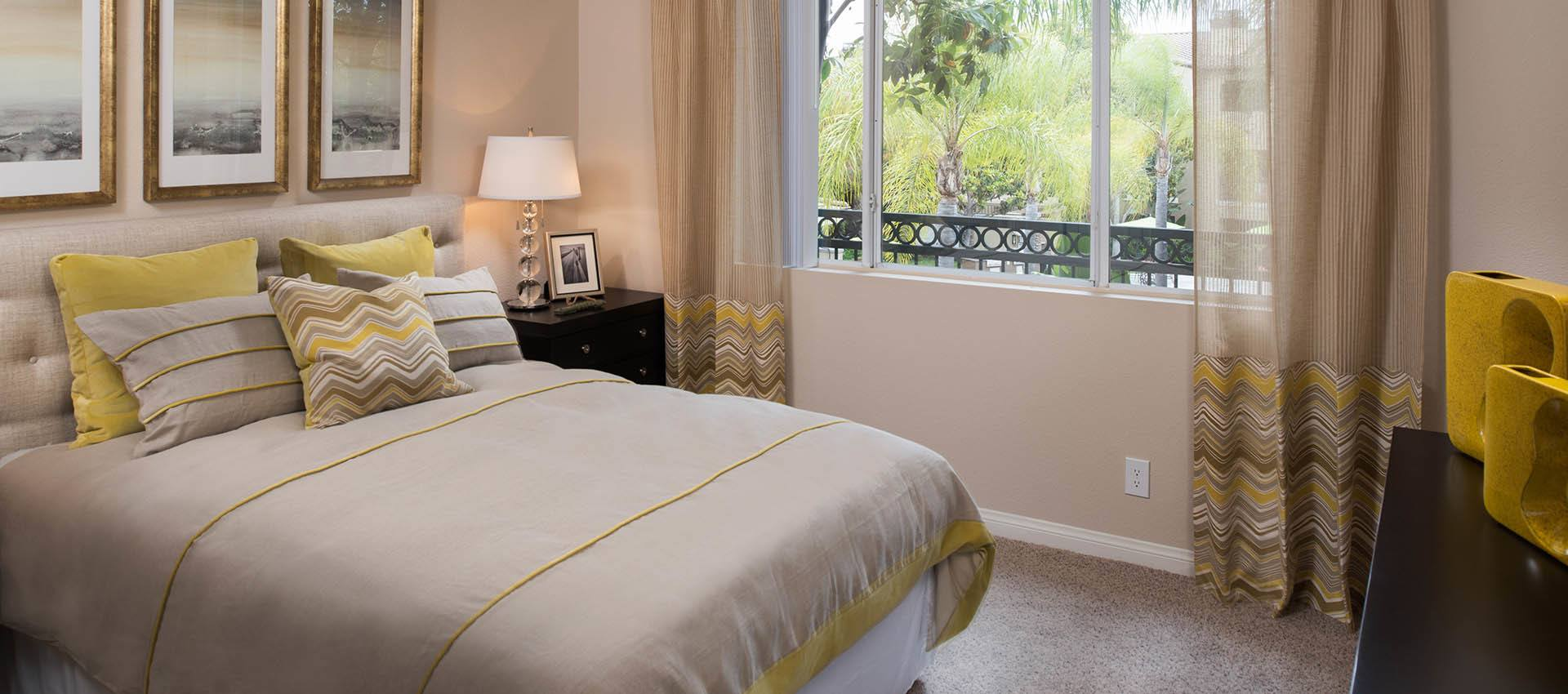 Comfortable Bedroom With Natural Light at Paloma Summit Condominium Rentals in Foothill Ranch, CA
