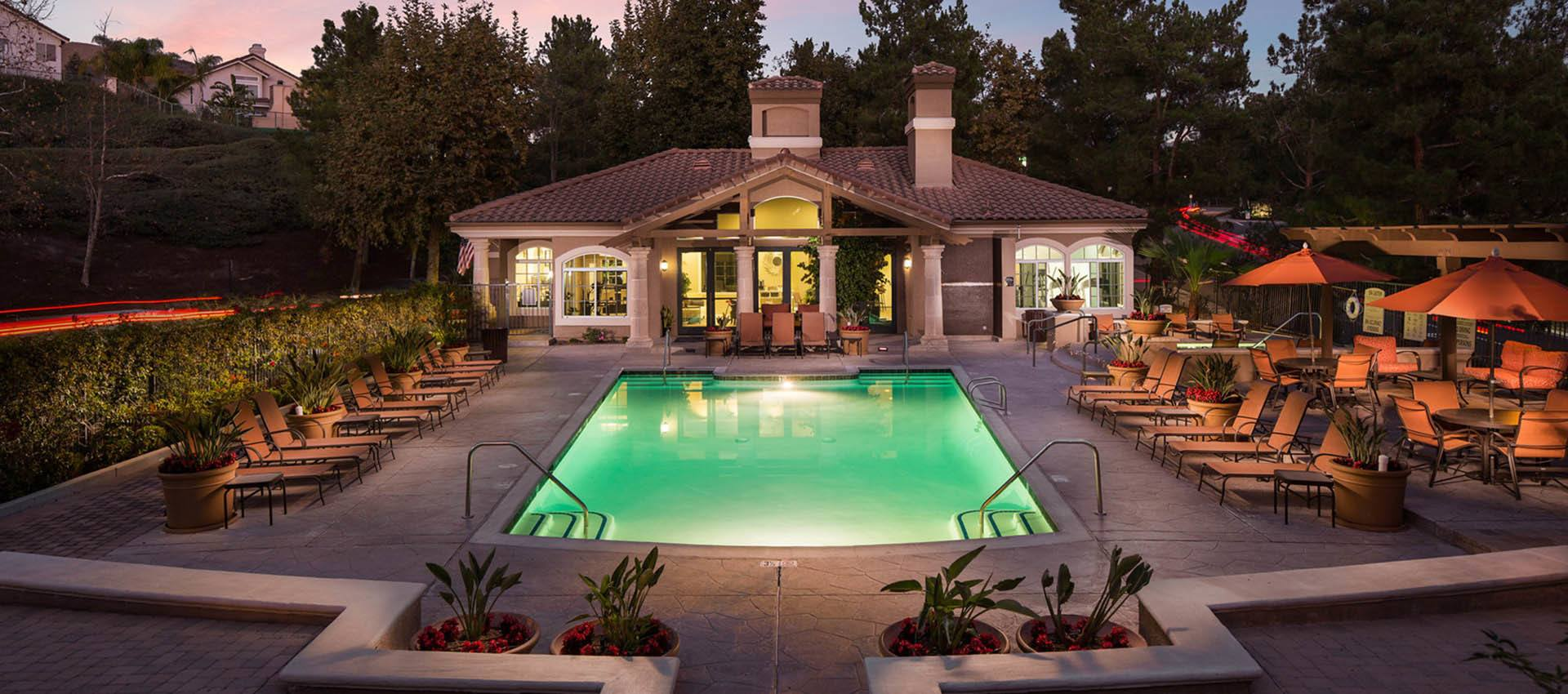 Resort Style Swimming Pool At Night at Paloma Summit Condominium Rentals in Foothill Ranch, California