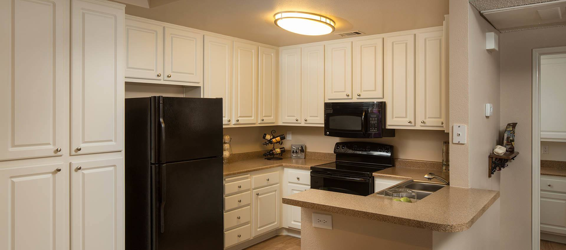 Standard Kitchen With Black Appliances at Paloma Summit Condominium Rentals in Foothill Ranch, CA