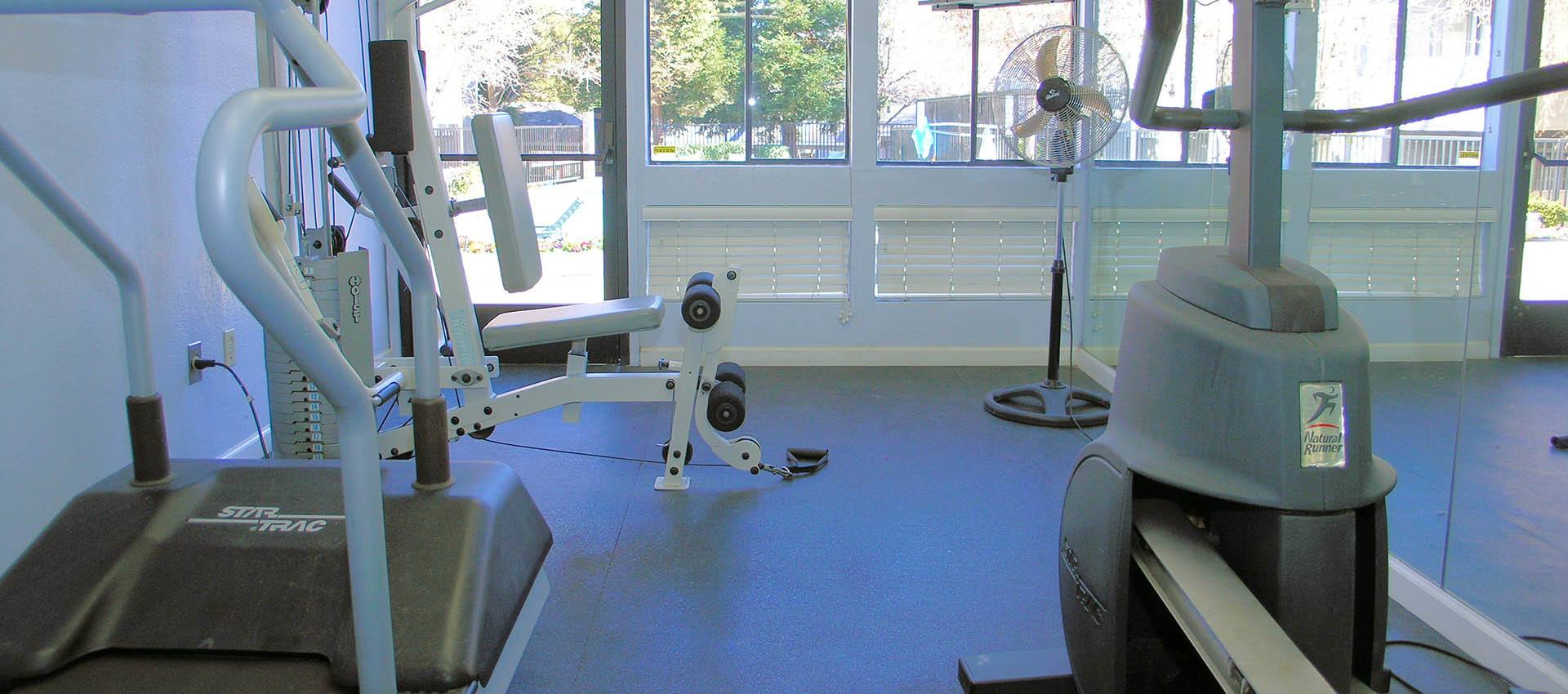 Cardio Equipment In Fitness Center at Plum Tree Apartment Homes in Martinez, CA